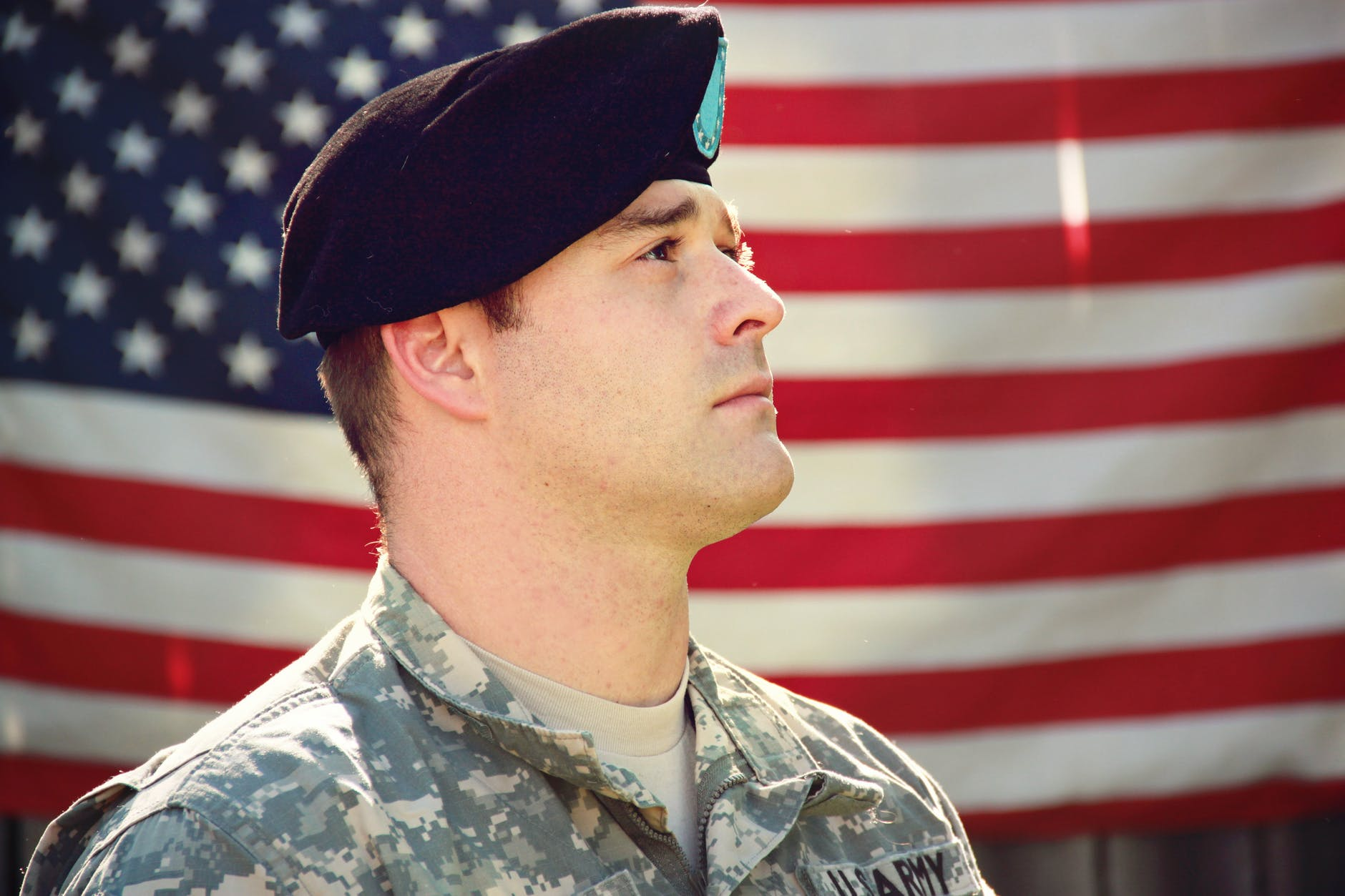 military man in front of the USA flag