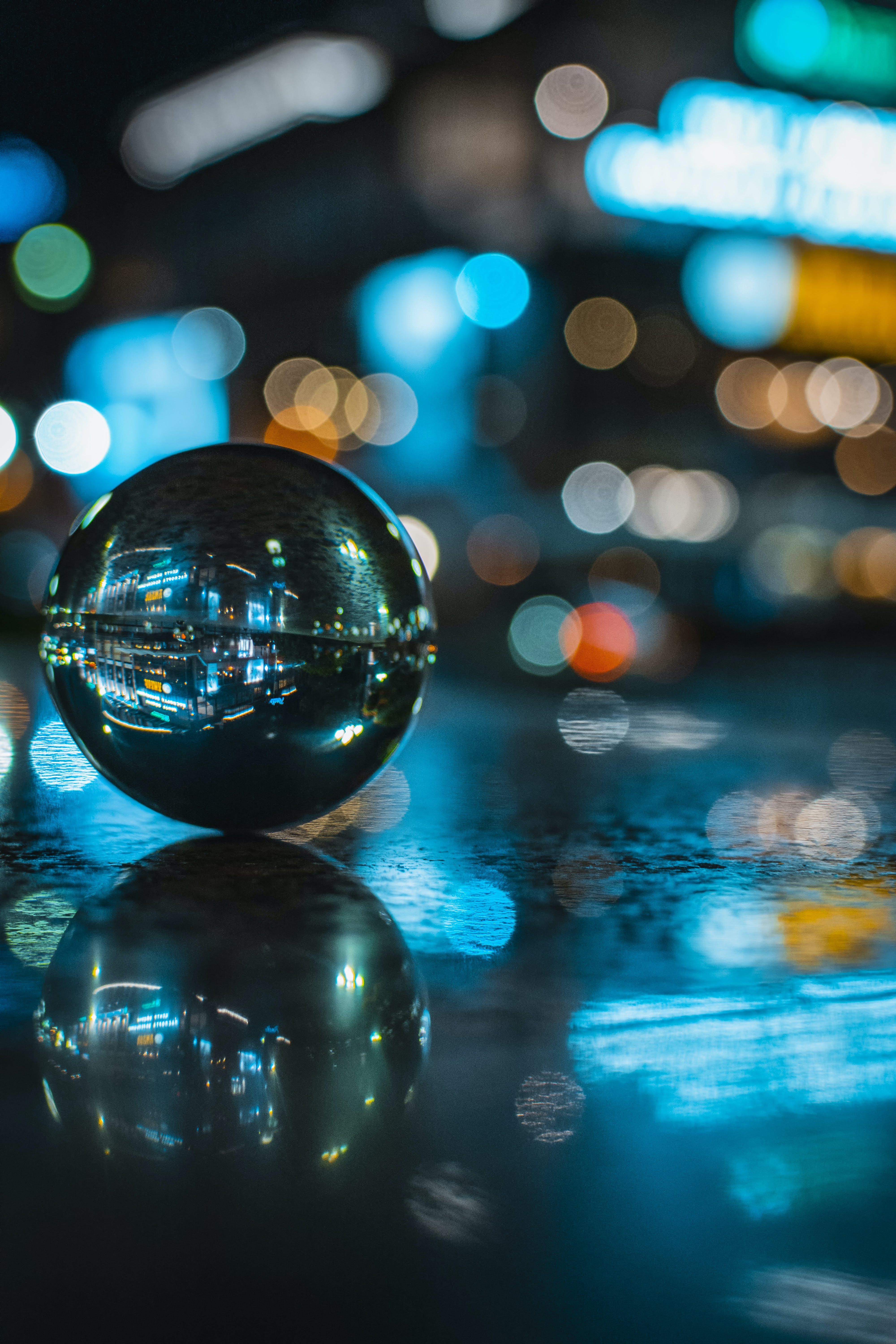 Glass Ball With Reflection of Lighted Building