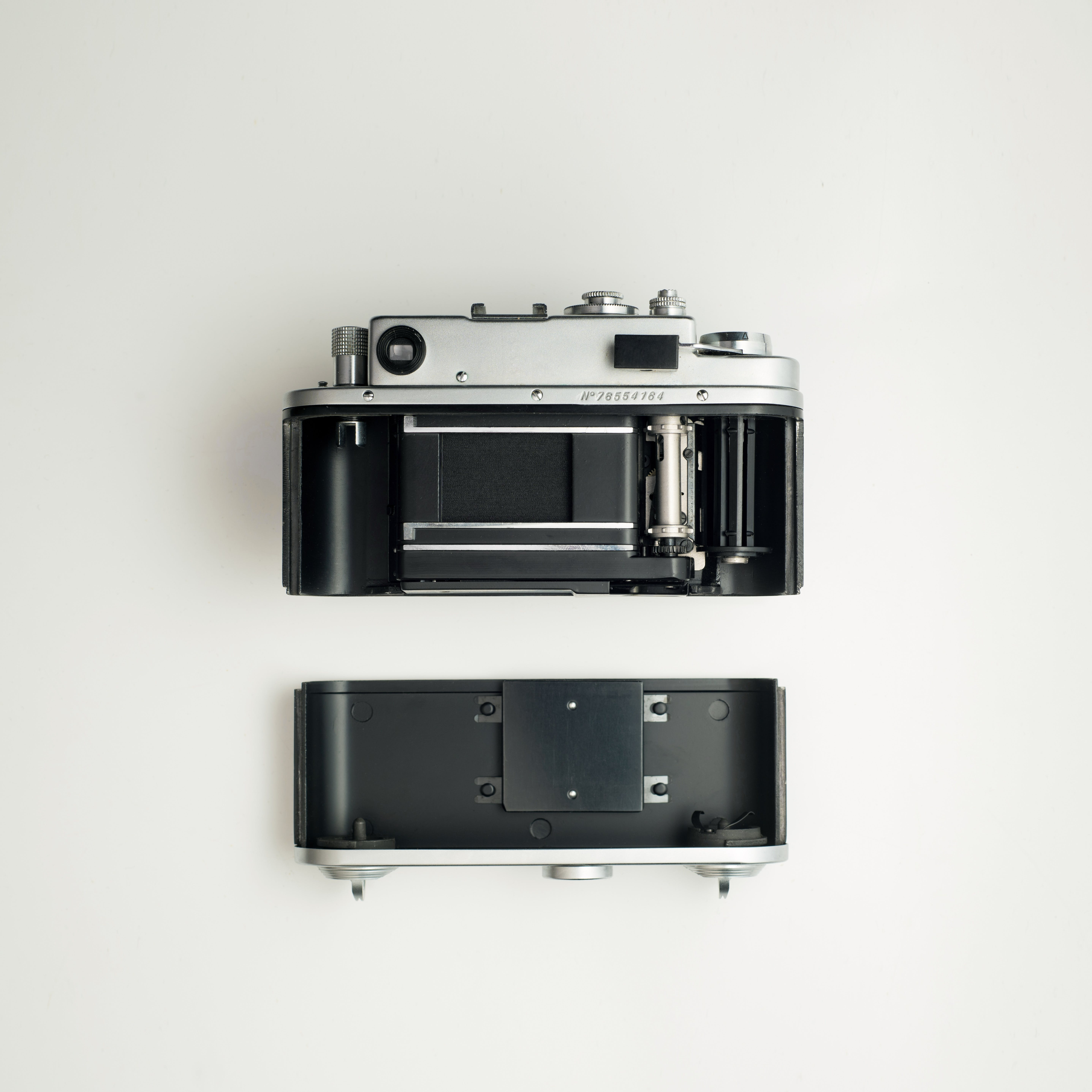 Black And Grey Camera On White Surface