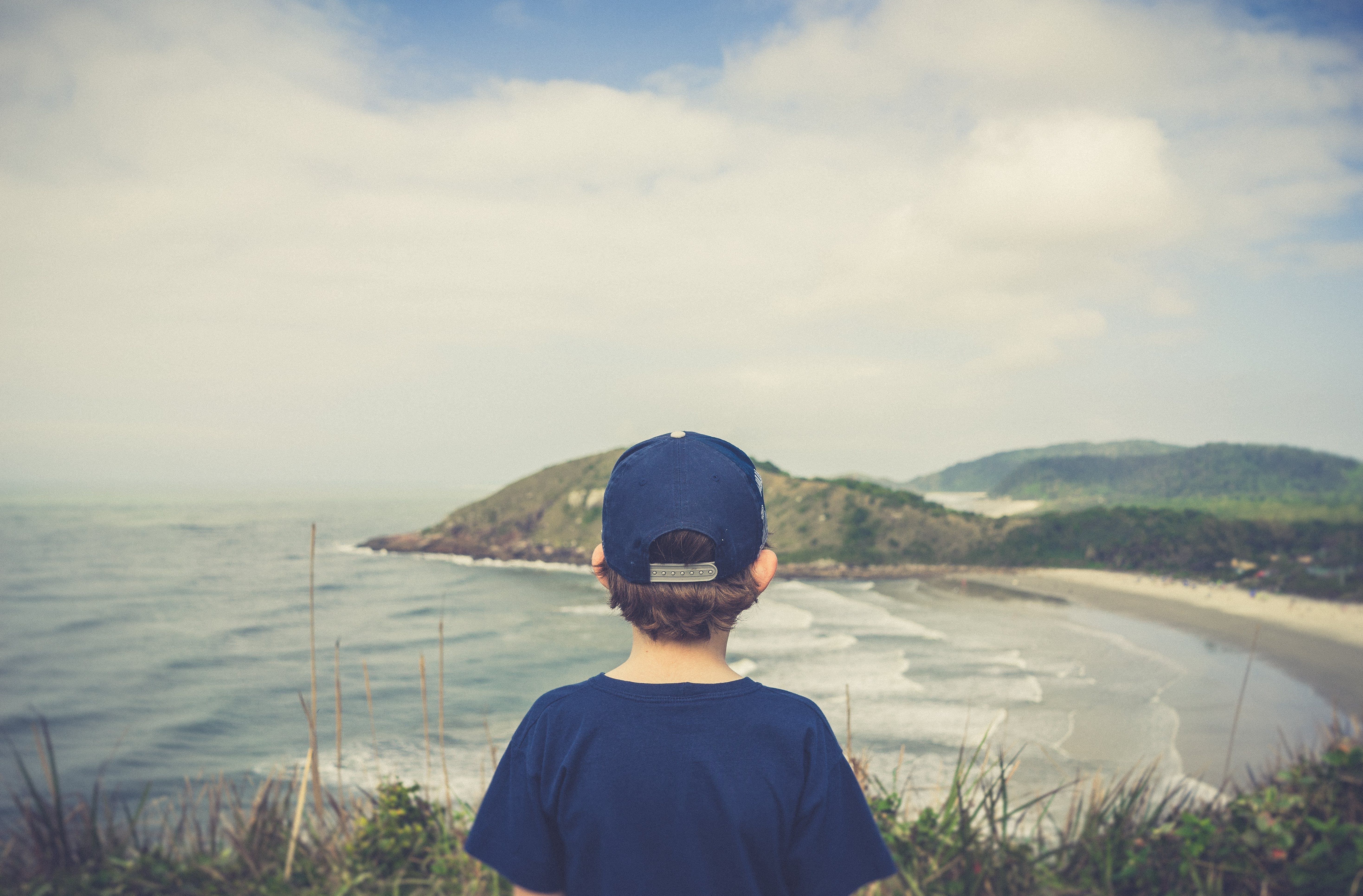 Boy Standing Near Cliff