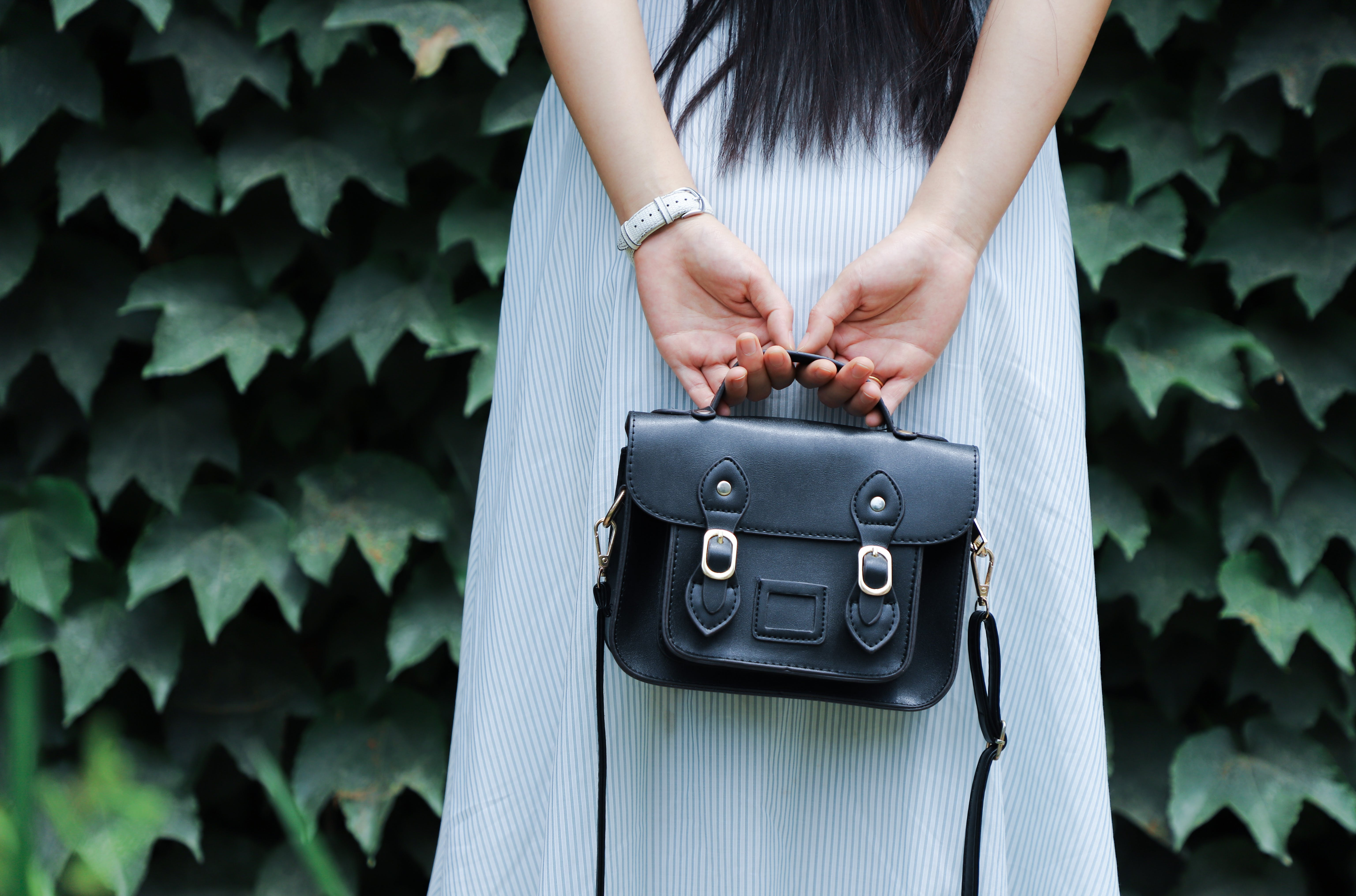 Woman Holding Black Leather Bag