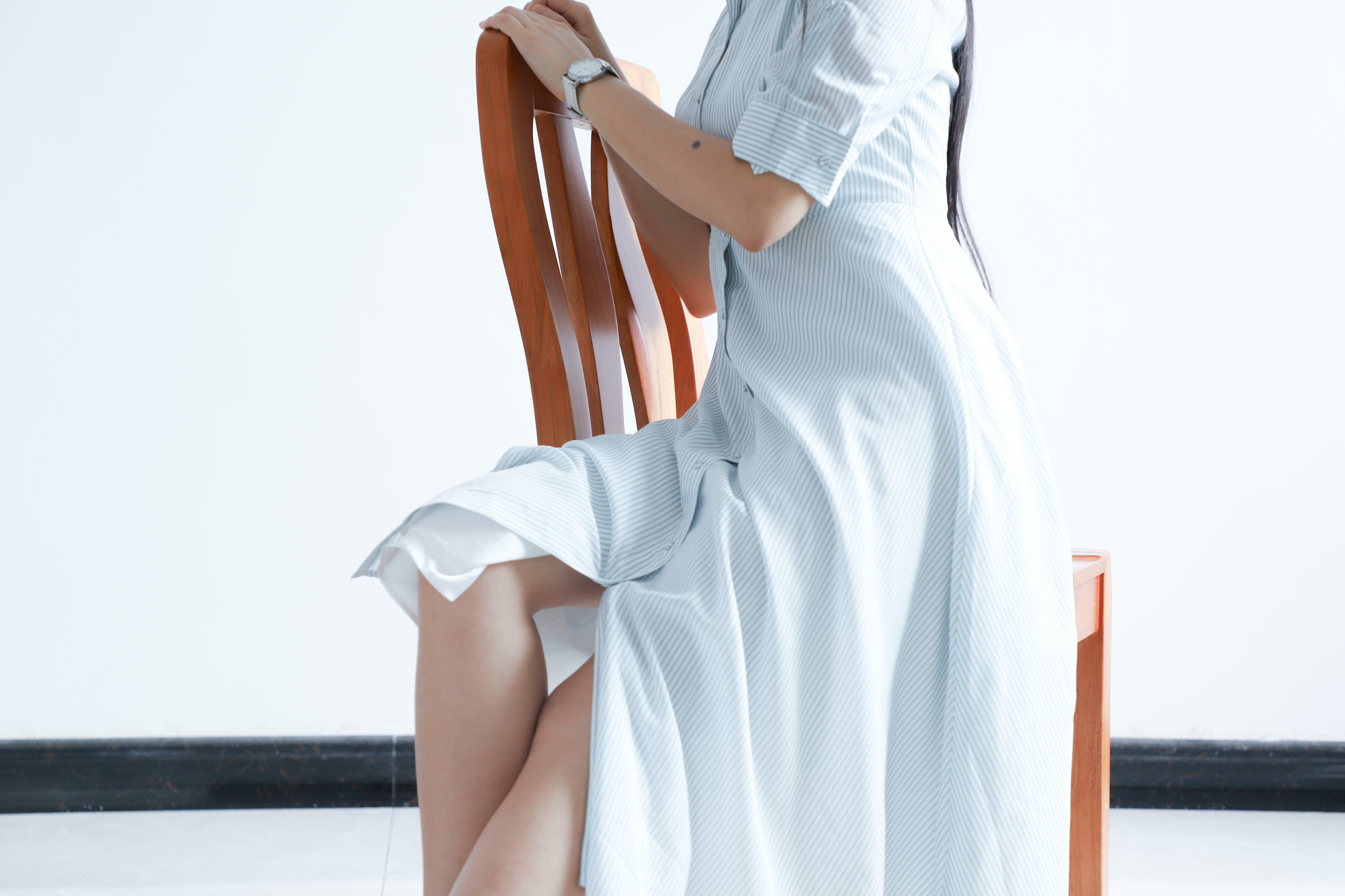 Woman Wearing Dress Sitting On Chair