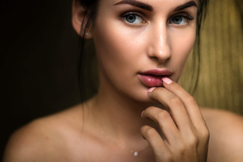 Photo Of Woman Holding Lips