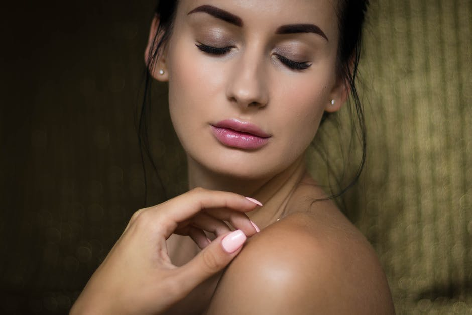 Woman With Closed Eyes Holding Her Shoulder