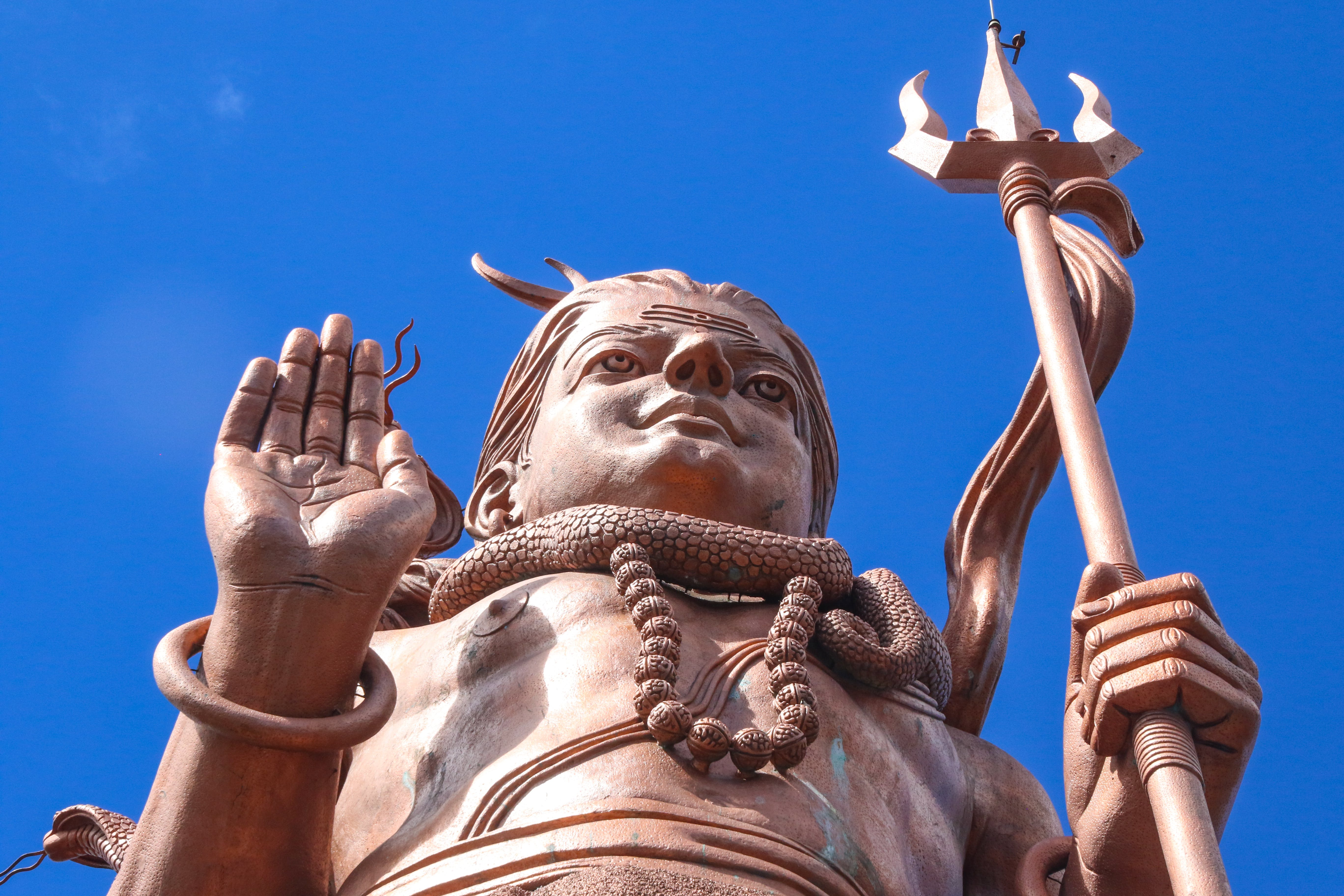 Free stock photo of hands, woman, statue, blue sky