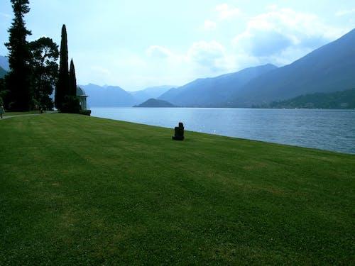 Free stock photo of grass, lake como, mountains, statue