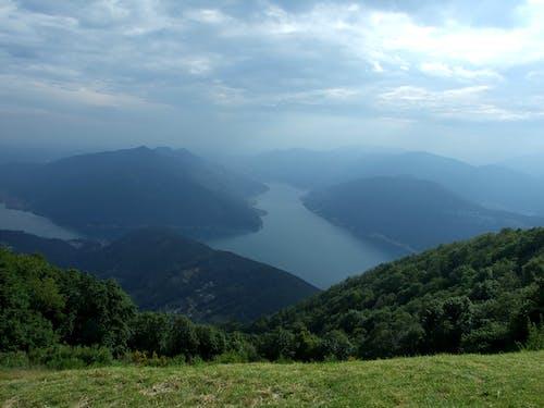 Free stock photo of fog, lake lugano, mountains, trees