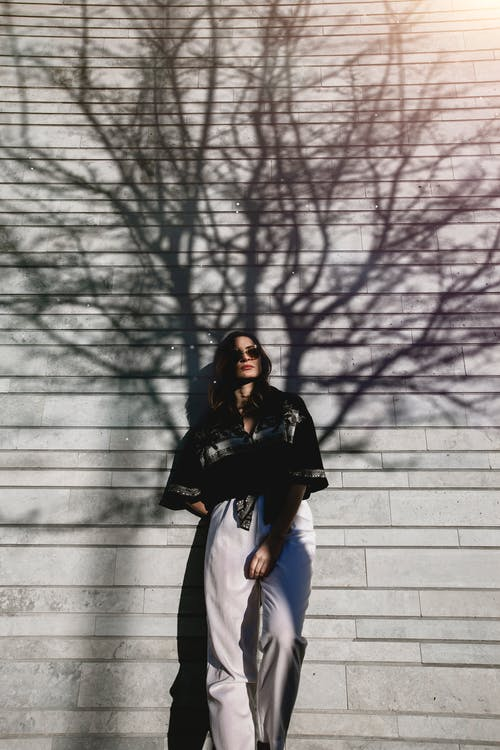 Photography of Woman Leaning On Wall