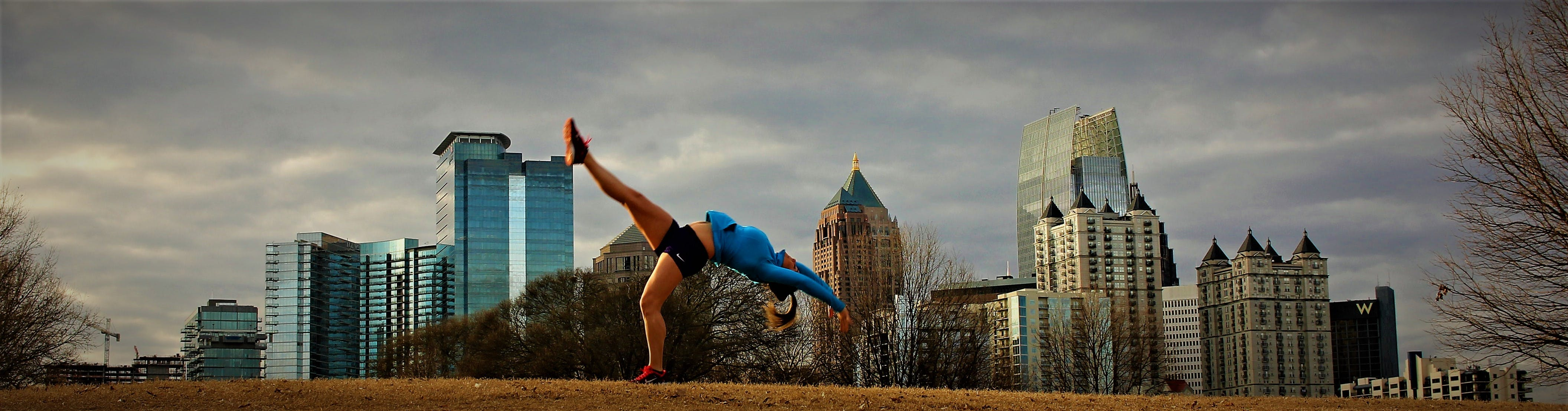 Free stock photo of buildings, city park, fitness model, gymnastics
