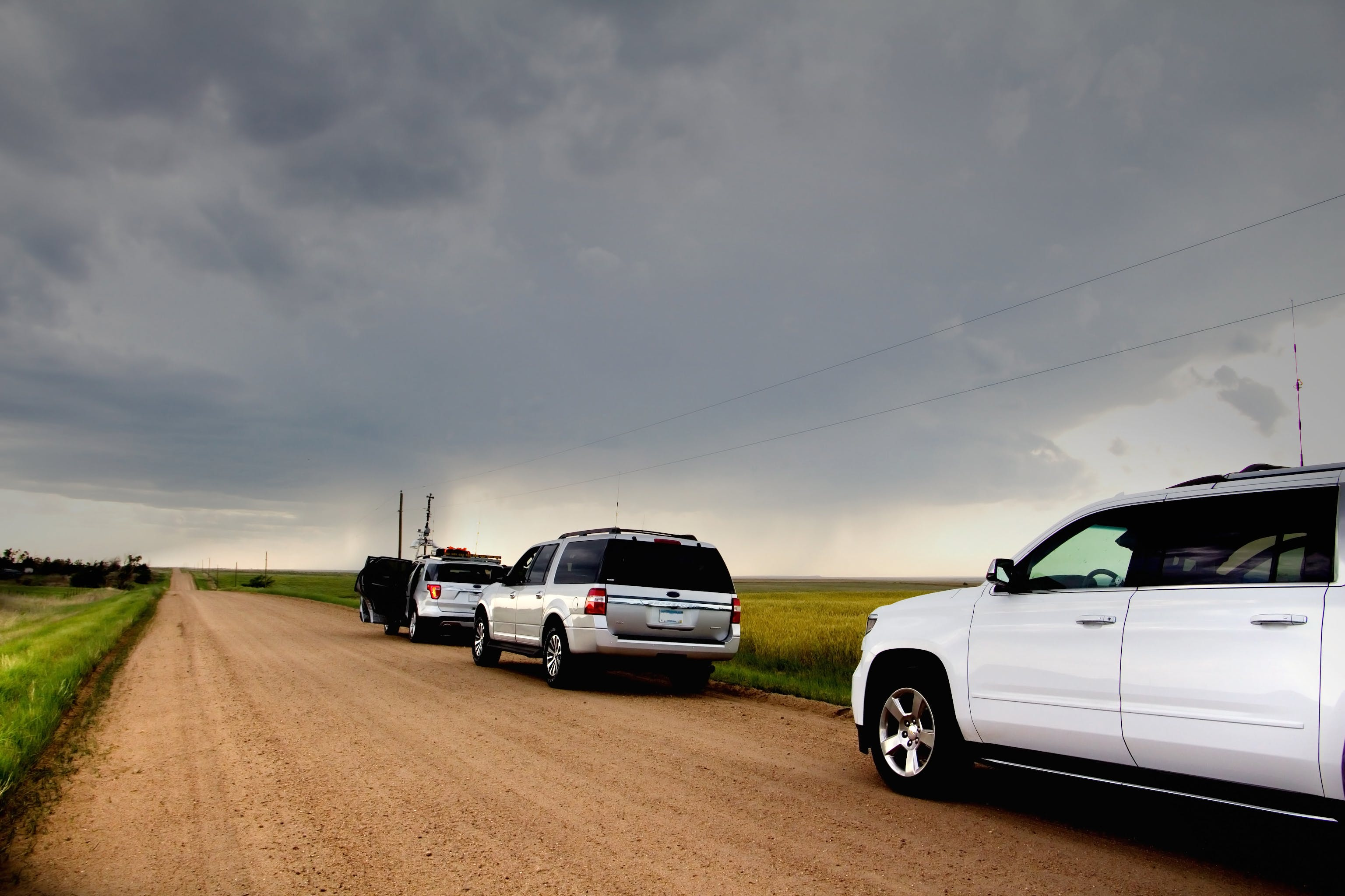 Free stock photo of clouds, dirt road, driving, meteorologist