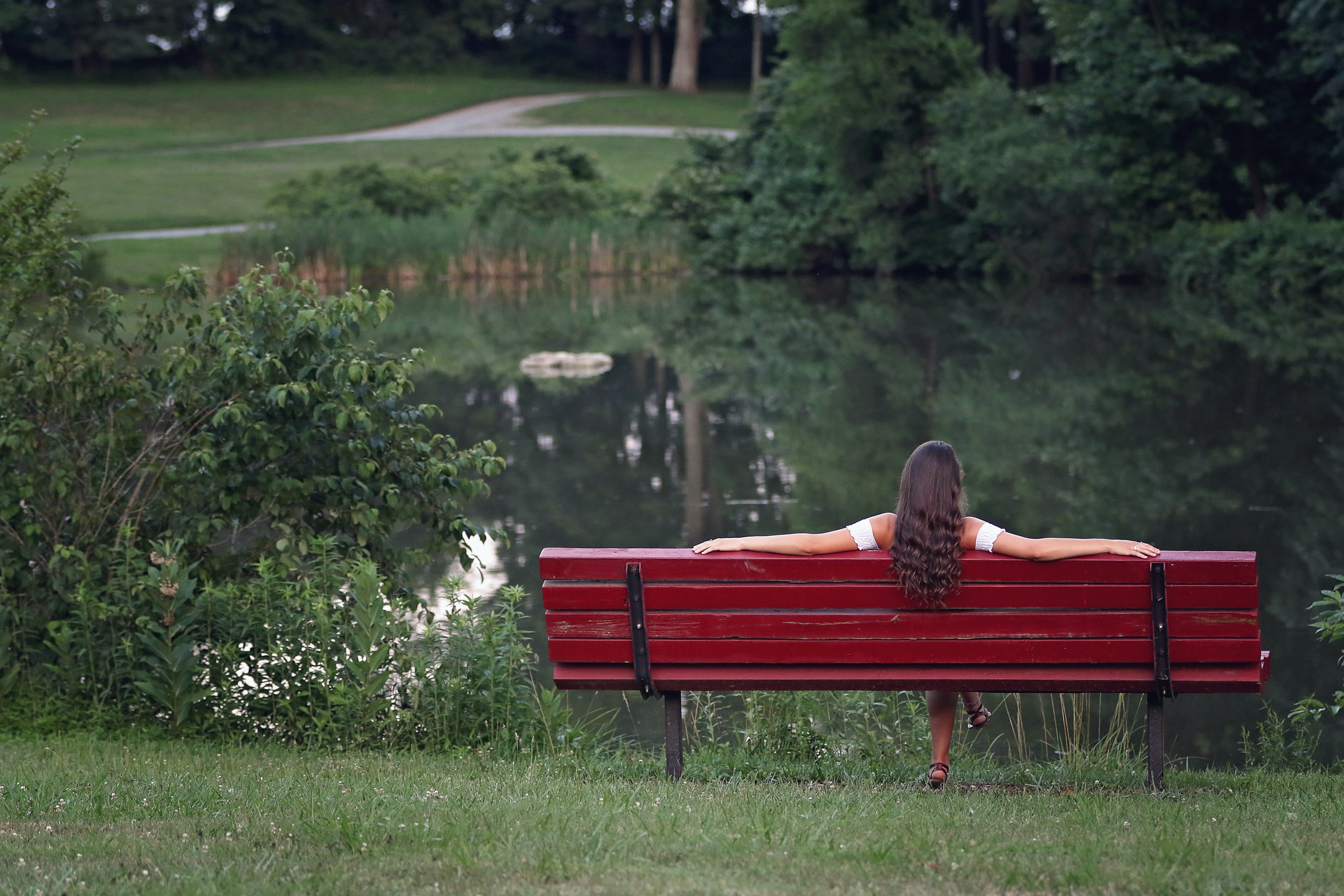 Photography of Woman Relaxing On Bench