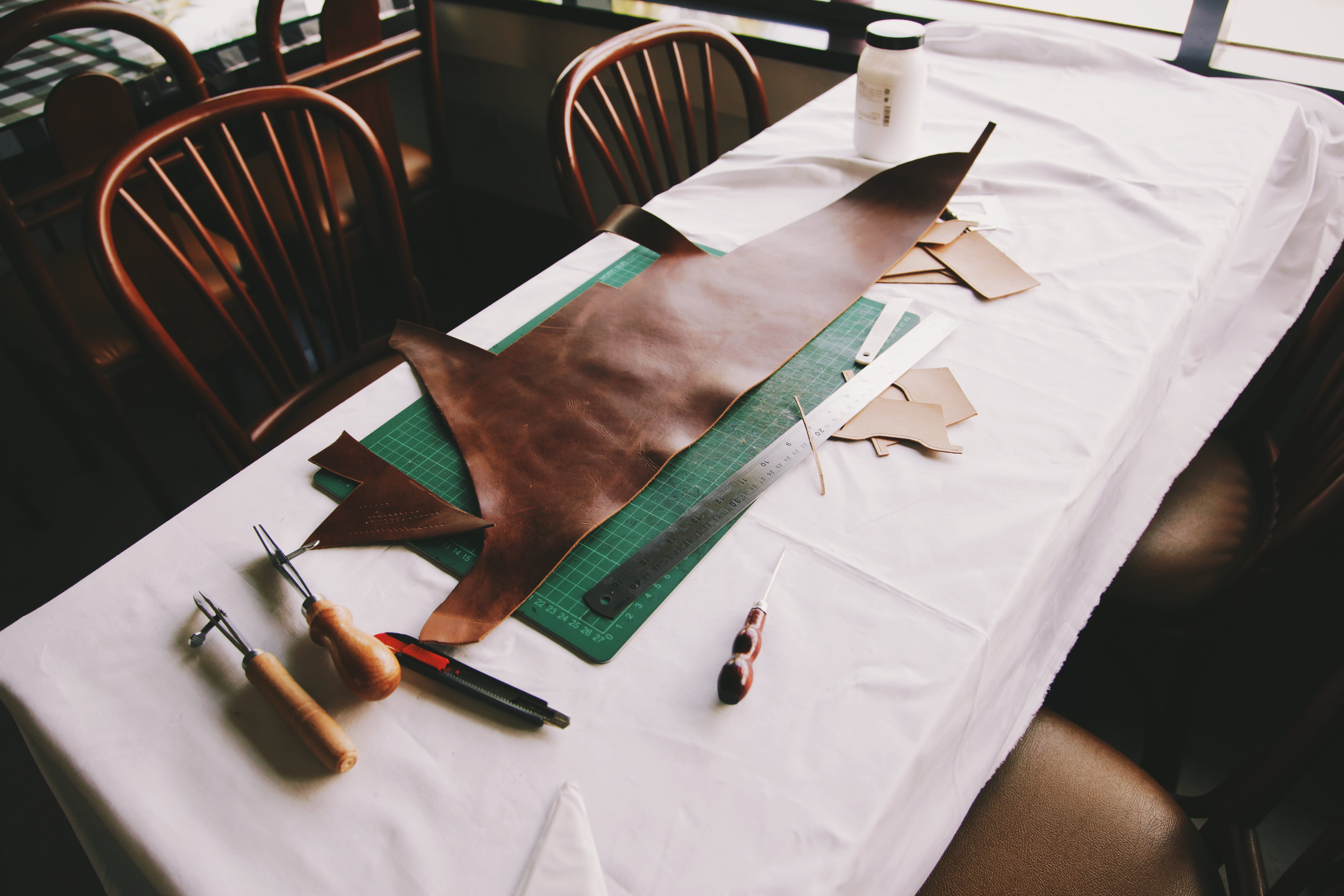 Brown Leather Textile on Top of Drafting Board