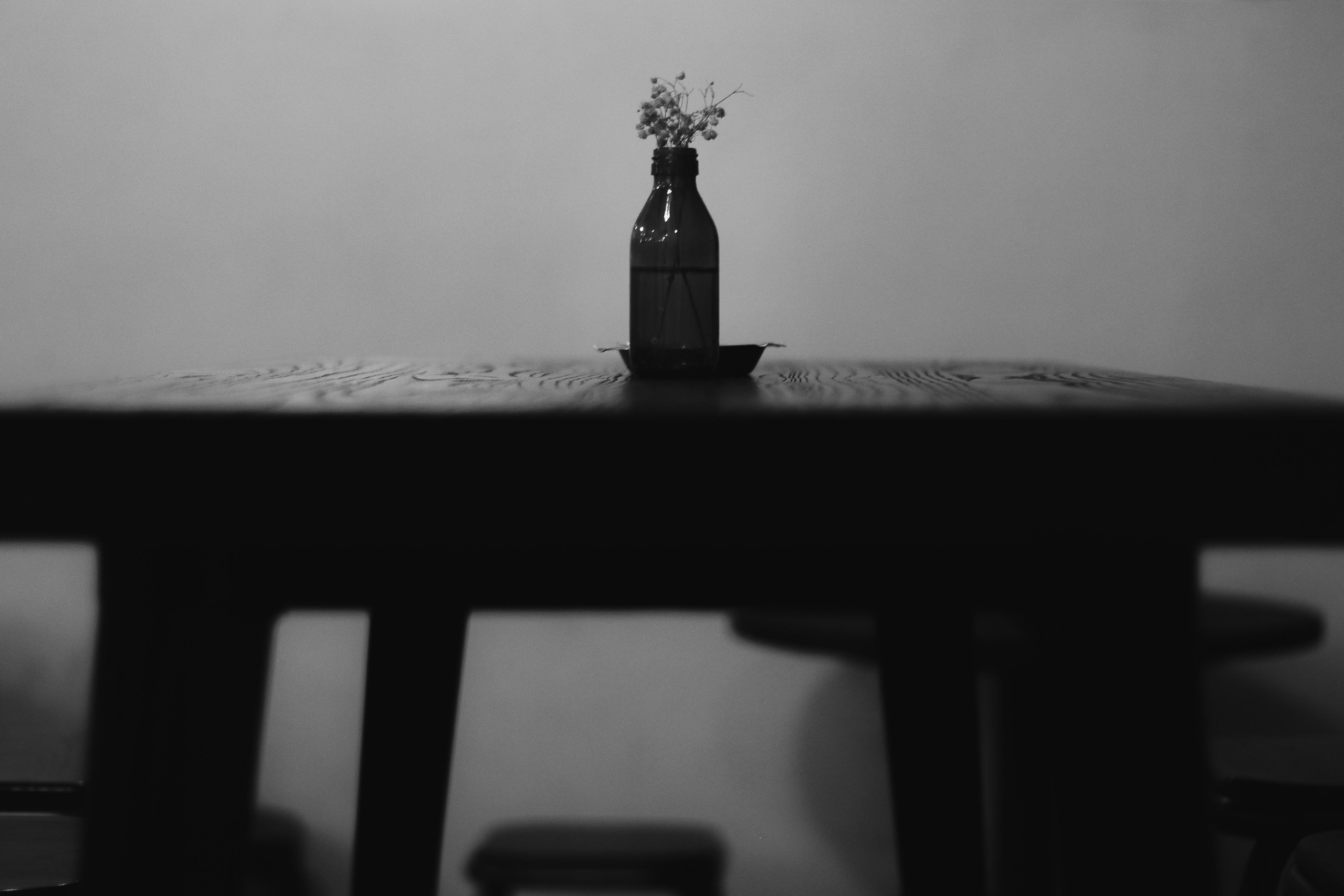 Bottle Flower Vase On Table