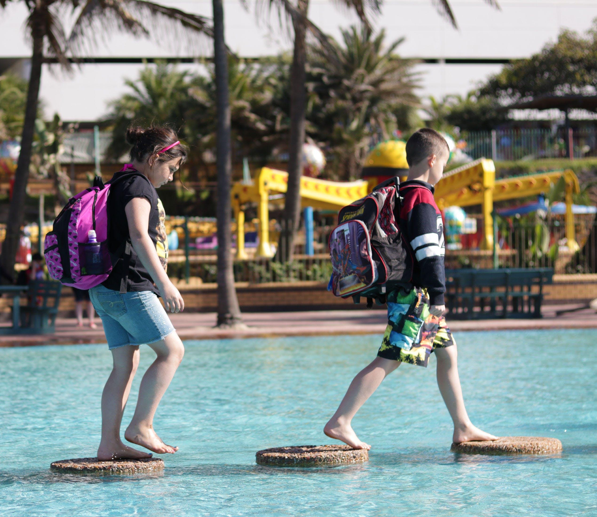 Free stock photo of children walking on water