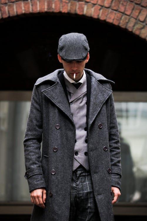 Photography of Man Wearing Gray Coat