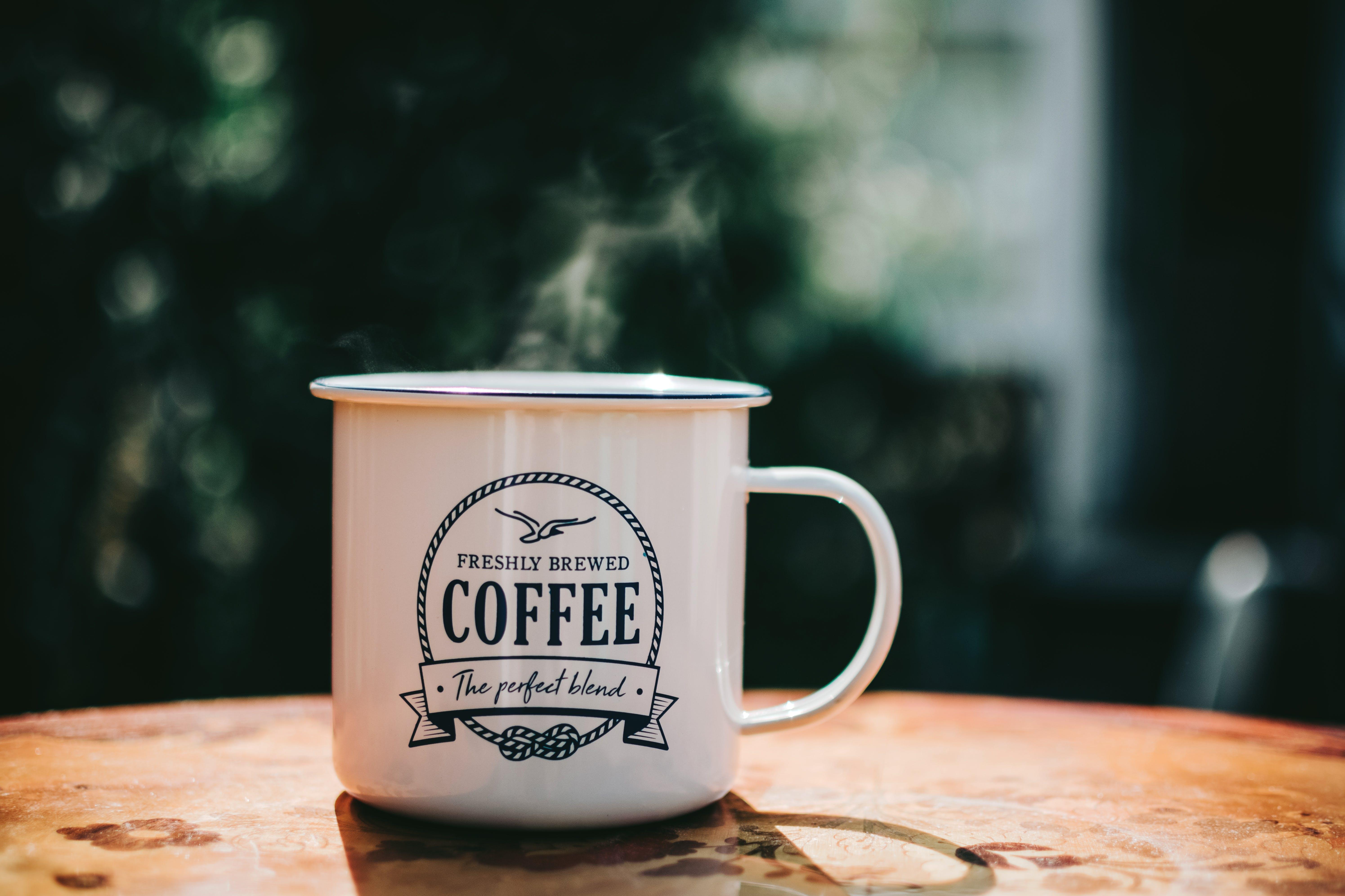 White Coffee Mug on Brown Surface