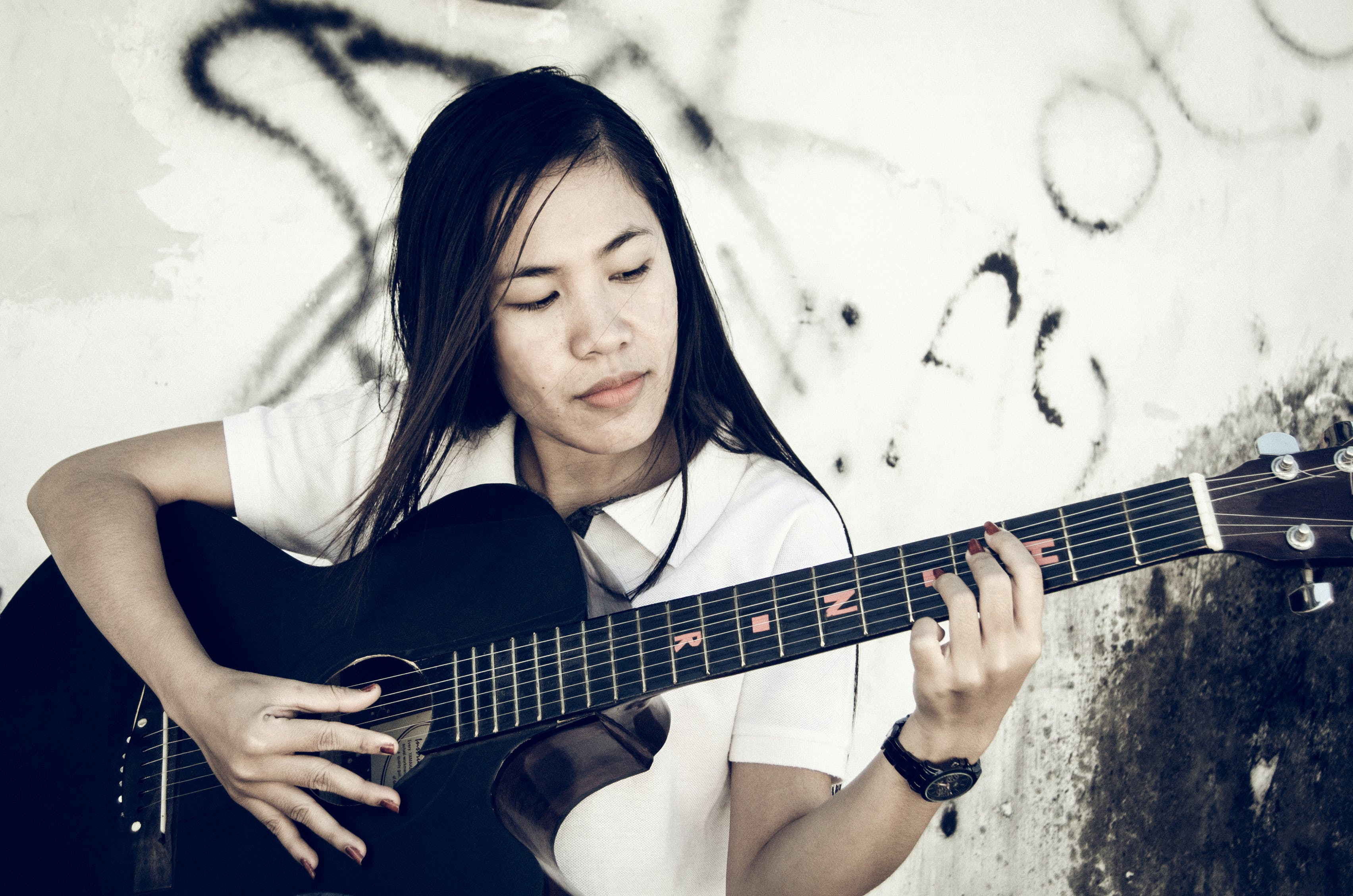 Free stock photo of playing, black, acoustic guitar, asian girl