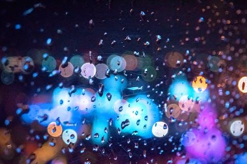 Foto profissional grátis de água, água na janela, bokeh claro, bokeh de água