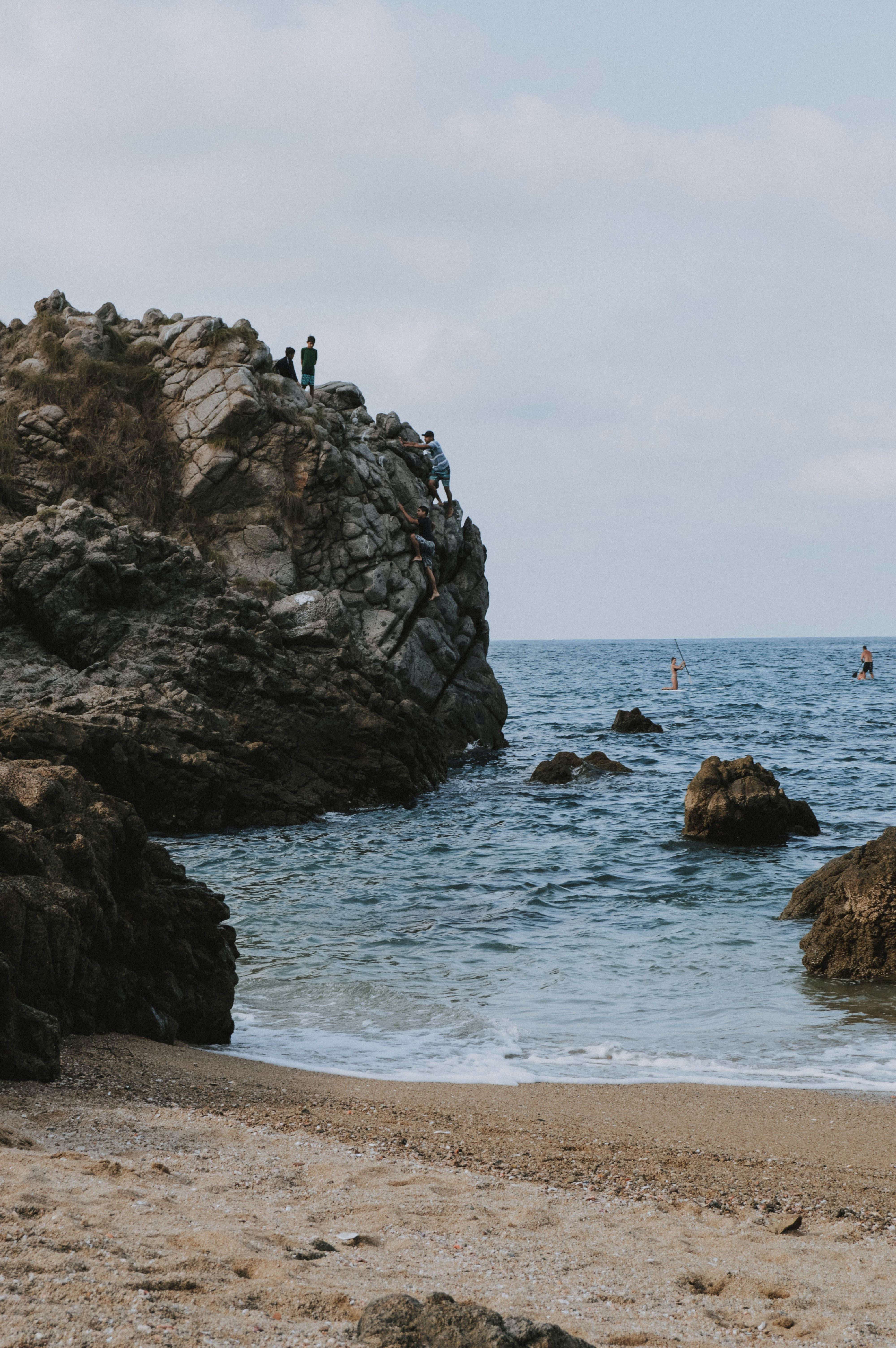 Photo of People on Top of a Rock Formation