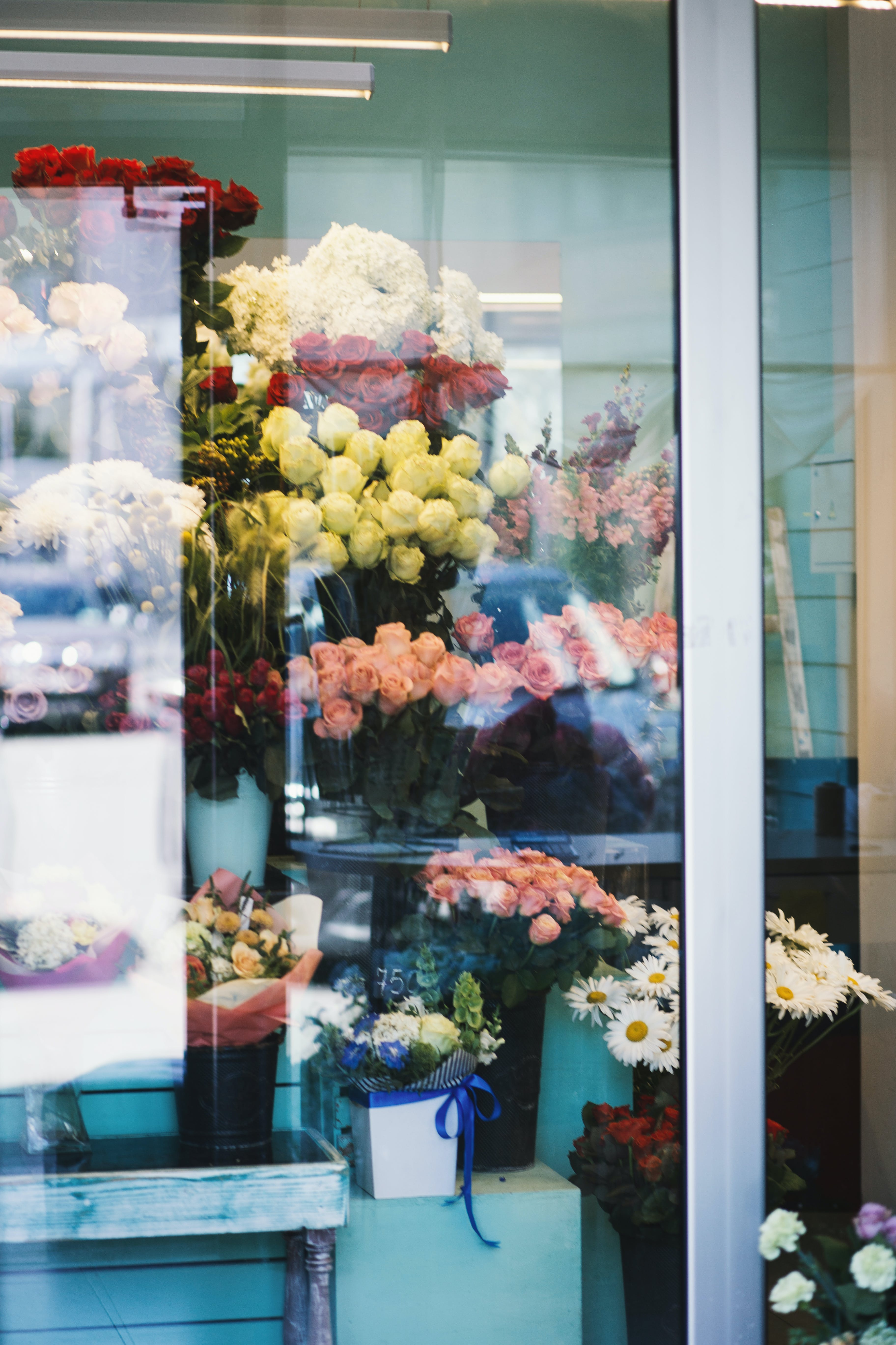 Assorted Flowers in Vases Inside Store