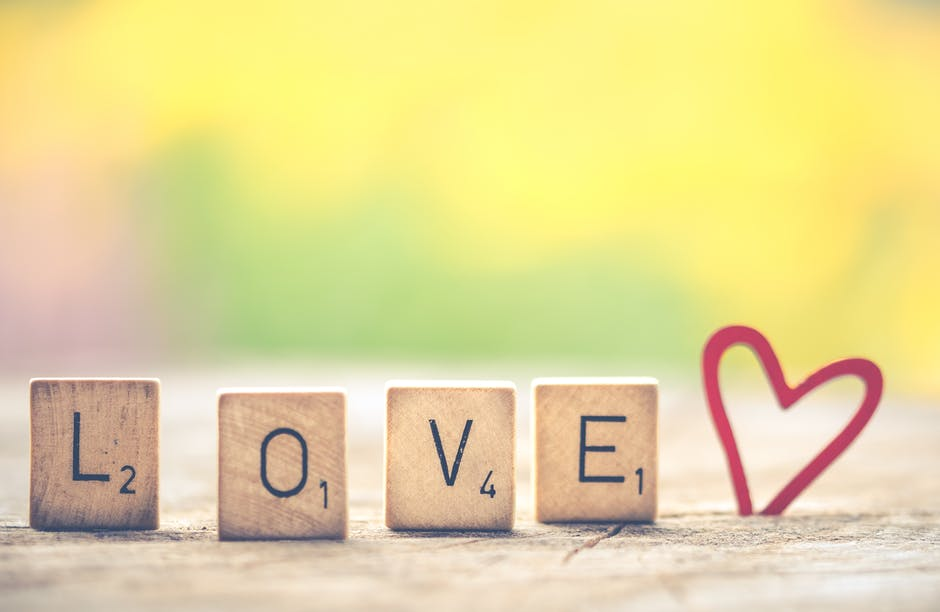 Scrabble tiles formed into love