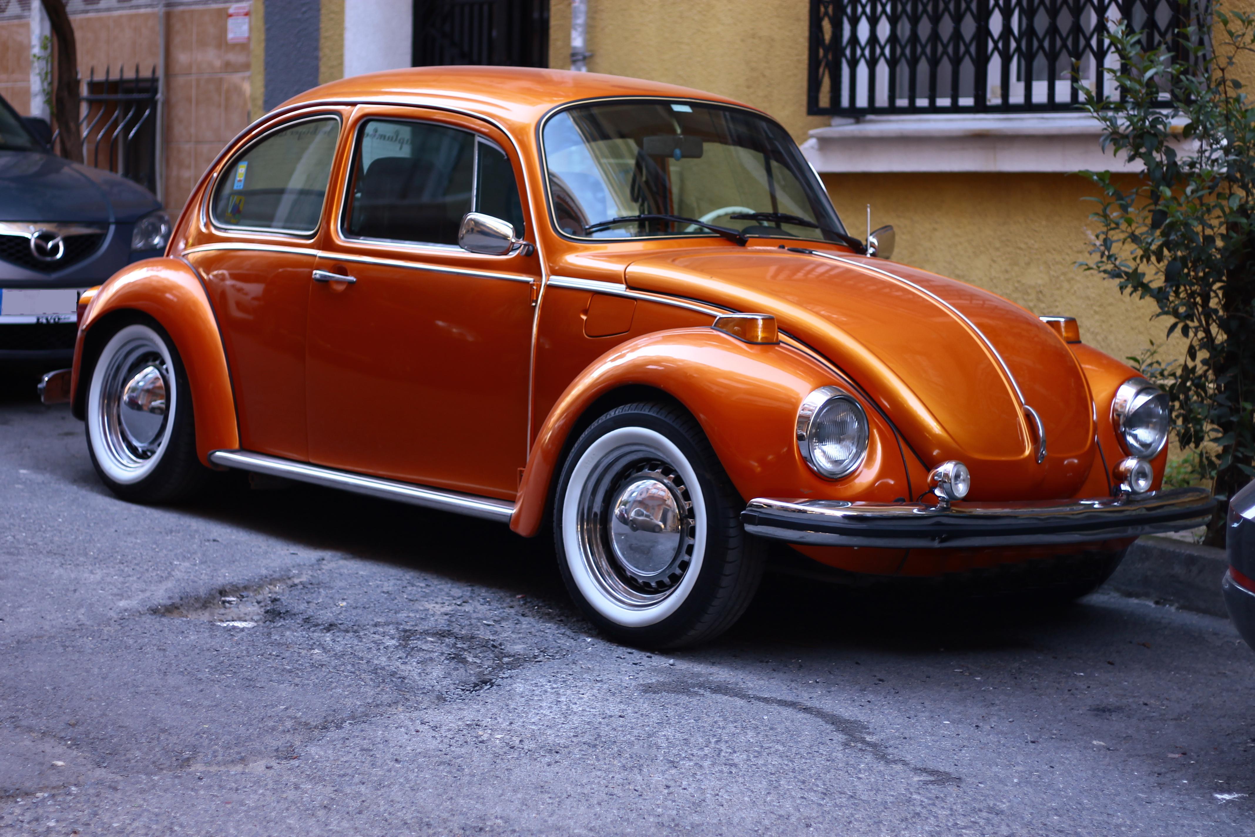 Photography of Orange Volkswagen Beetle