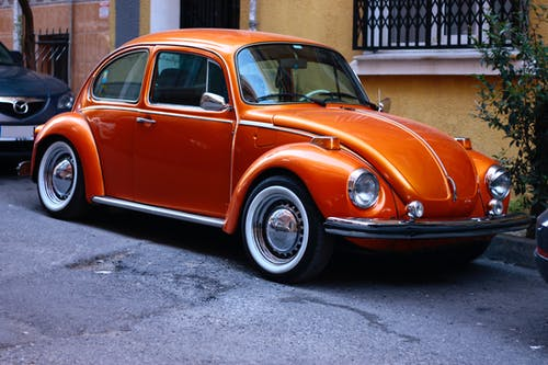 Photography of Orange Volkswagen Beetle