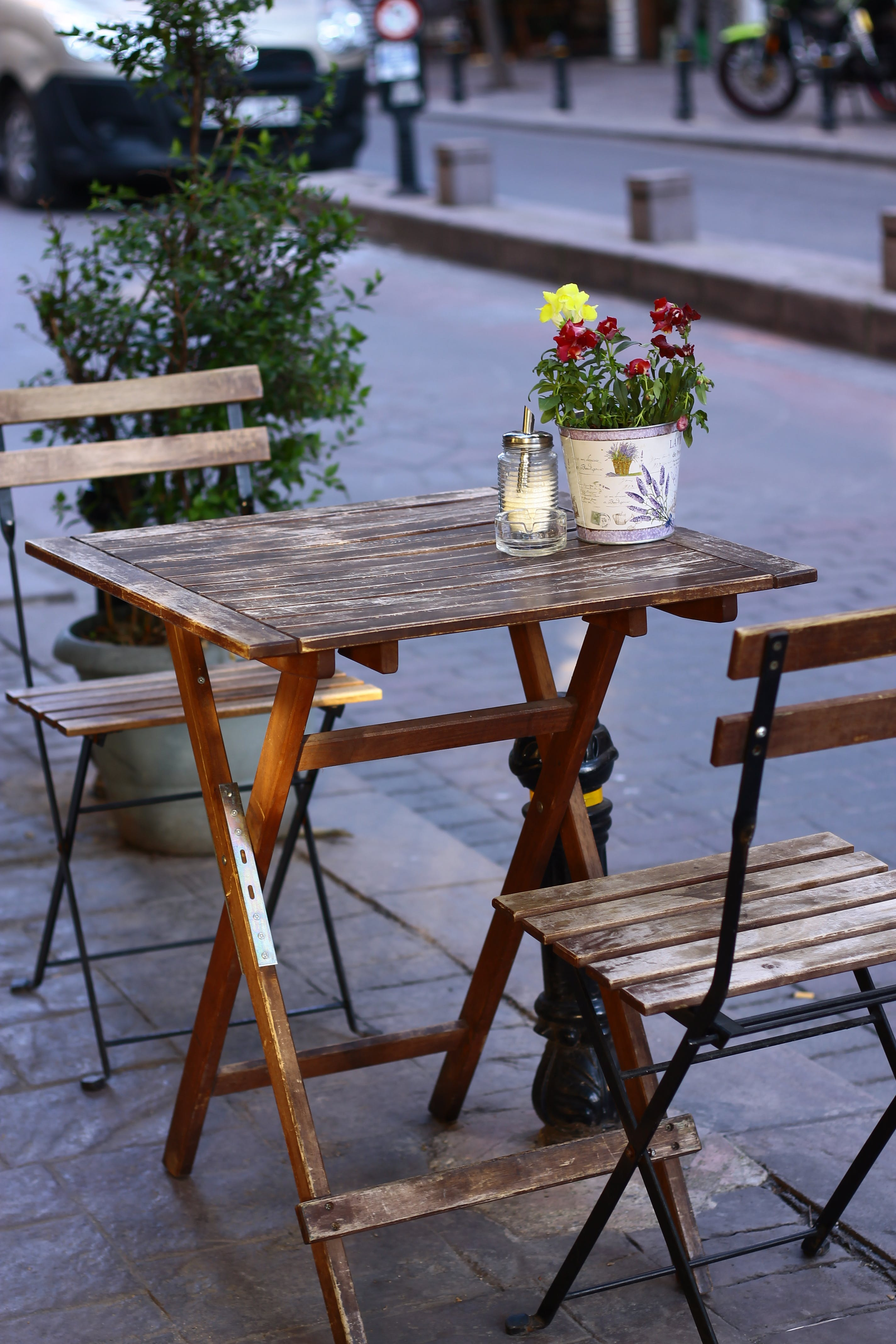 Shallow Focus Photography of Brown Wooden Folding Table With Chairs