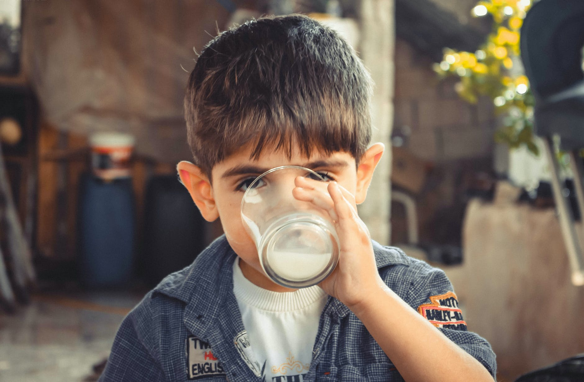 child drinking a glass of milk