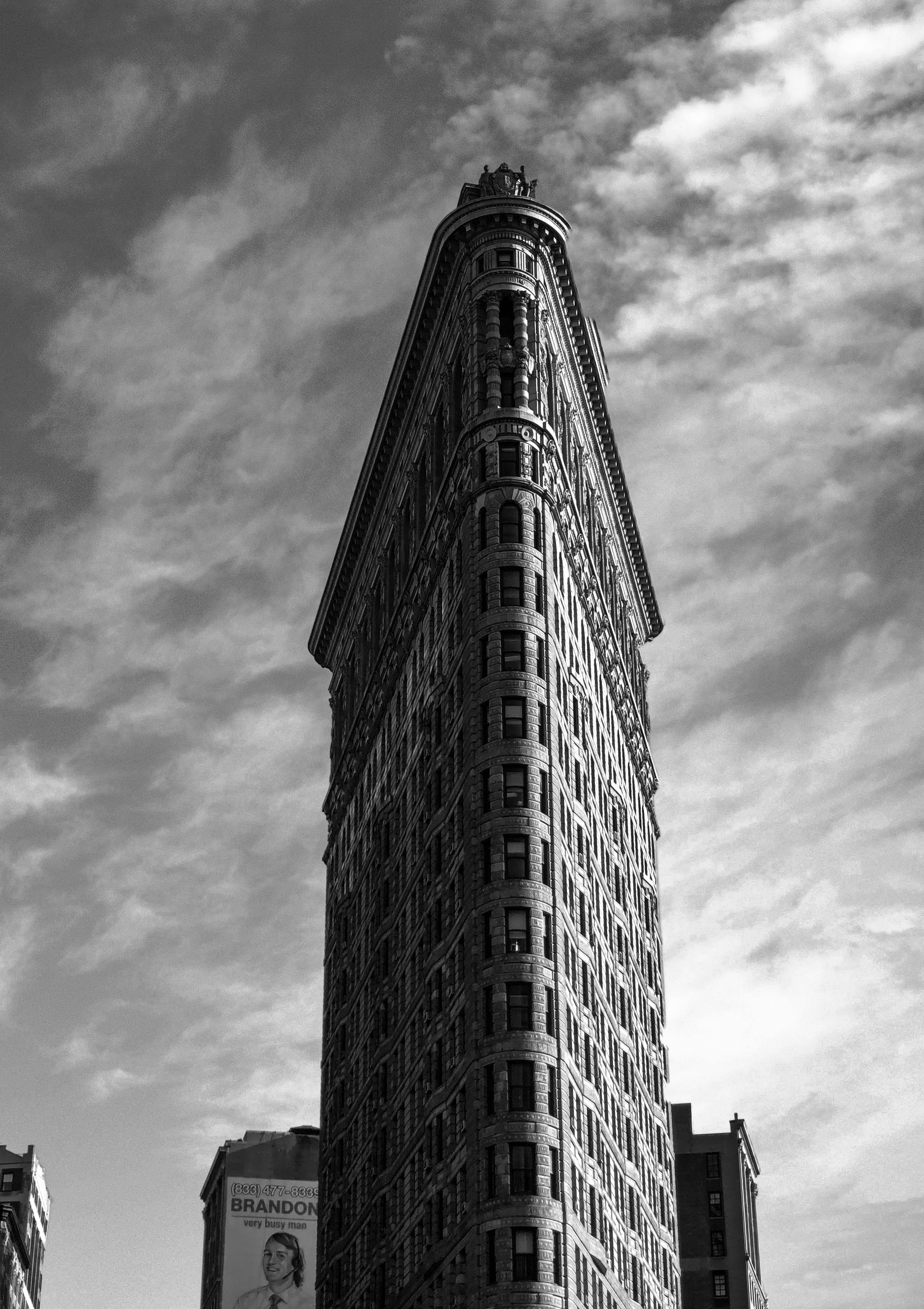 Grayscale Photography Of Flatiron Building Free Stock Photo