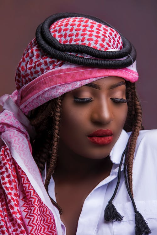 Woman Wearing Red, White, and Black Keffiyeh Head Dress