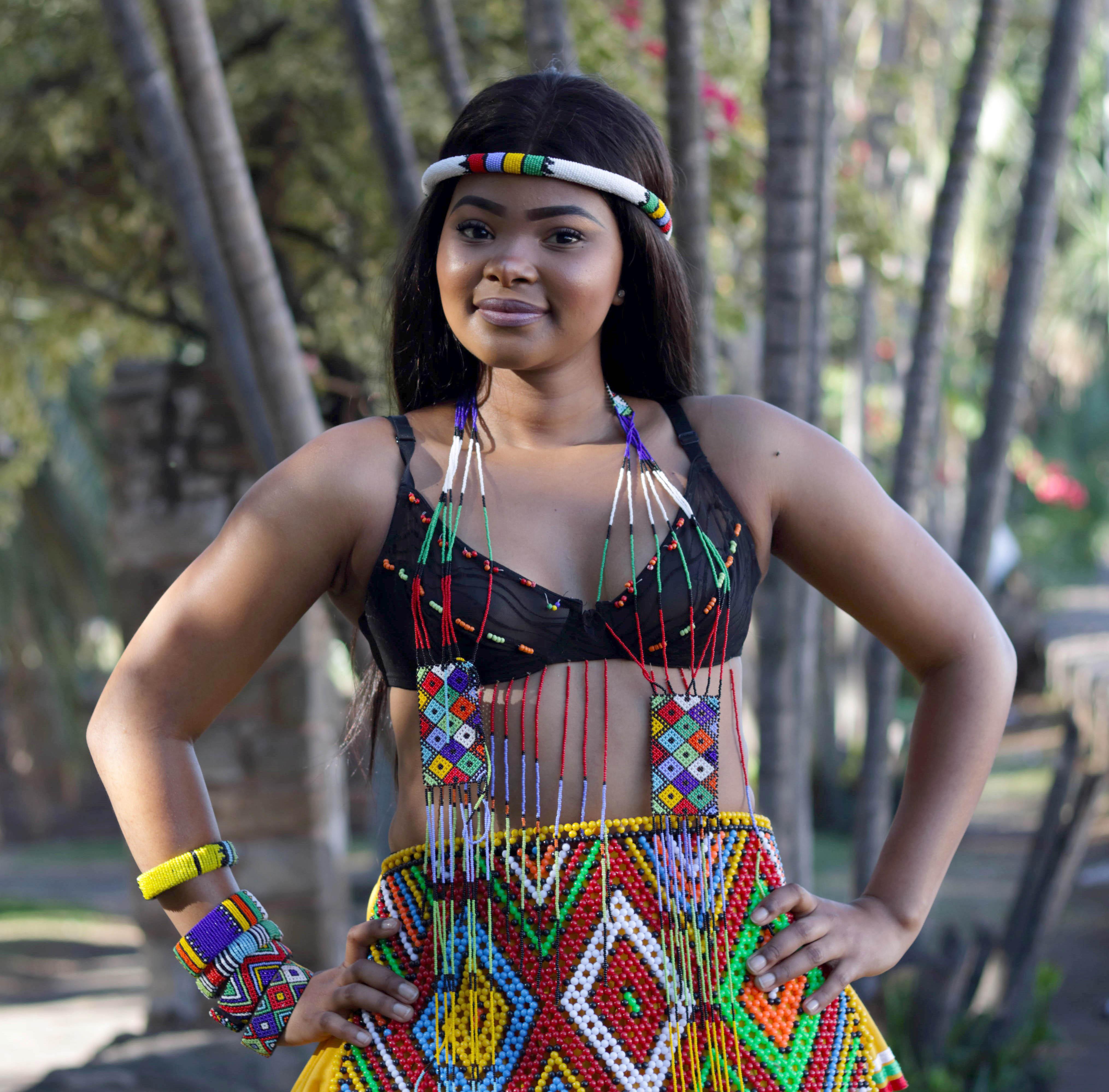 Woman Wearing Beaded Dress Looking at Camera