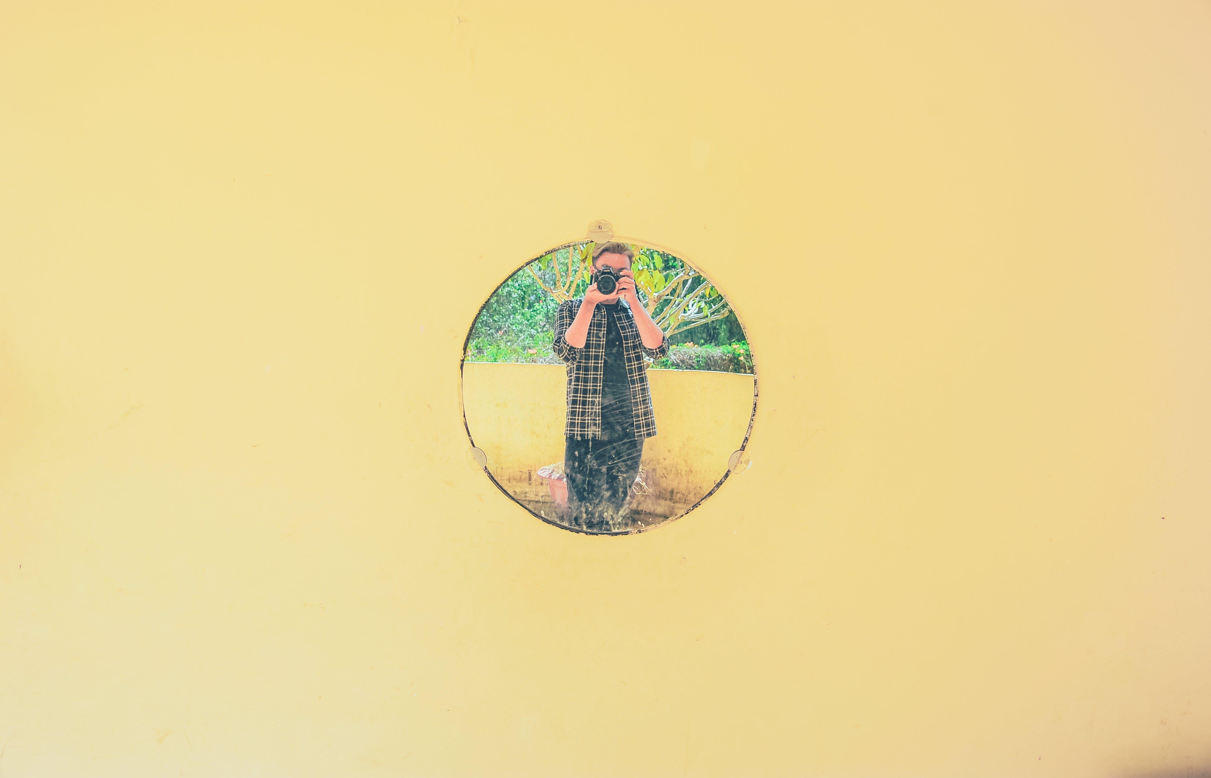 Person Taking Photo Icon