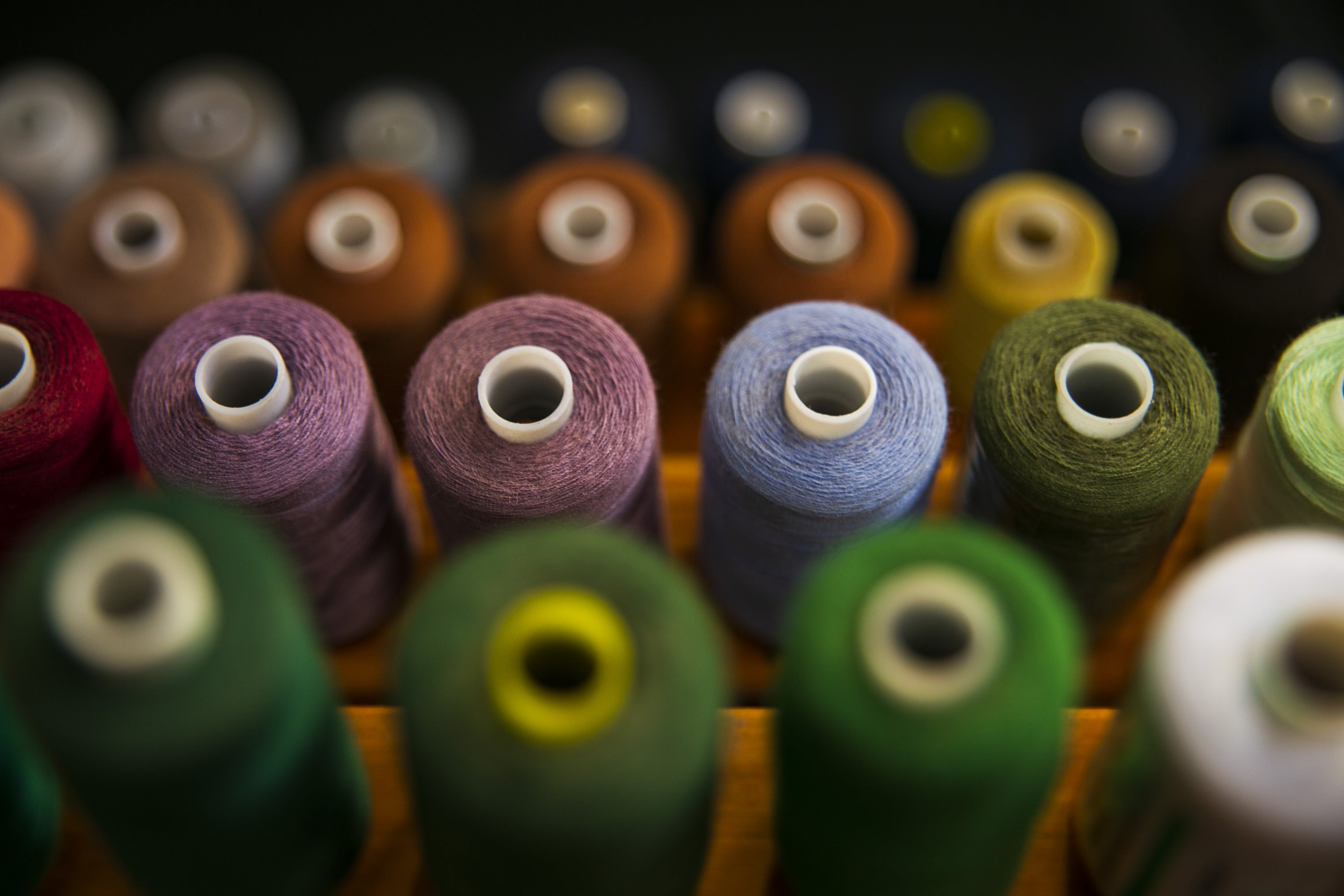 Selective Focus Photography Of Assorted Coloured Thread Spools