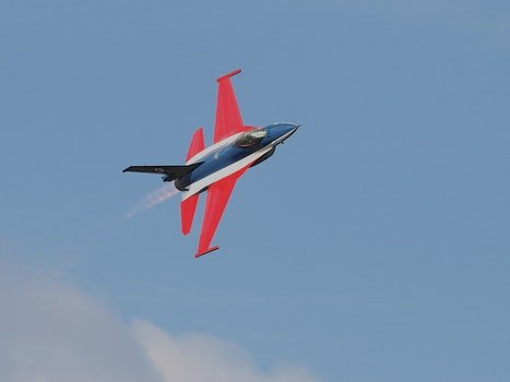 Blue Red Black and White Jet Plane on Air