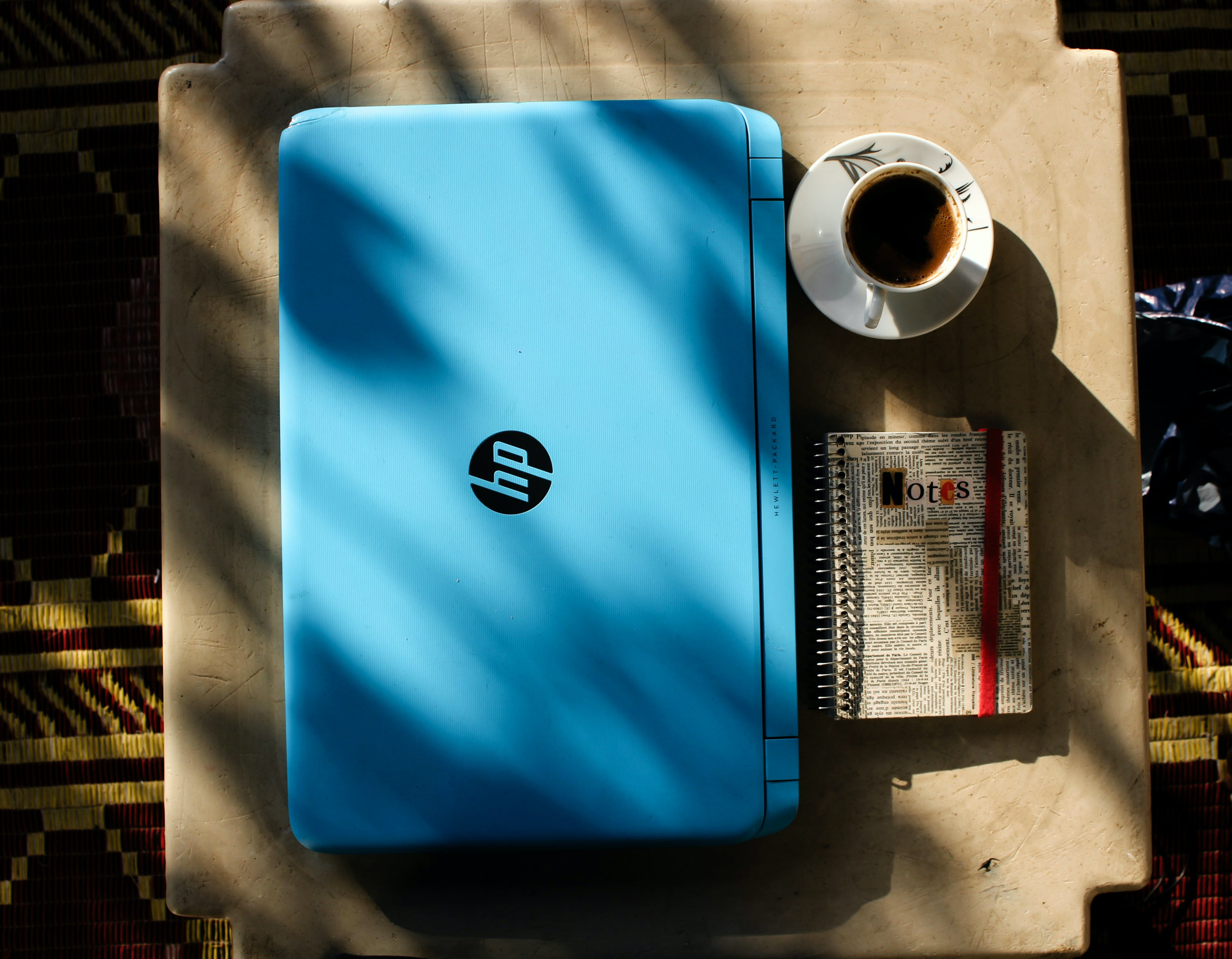 Top View Photo of Laptop Near Coffee Cup