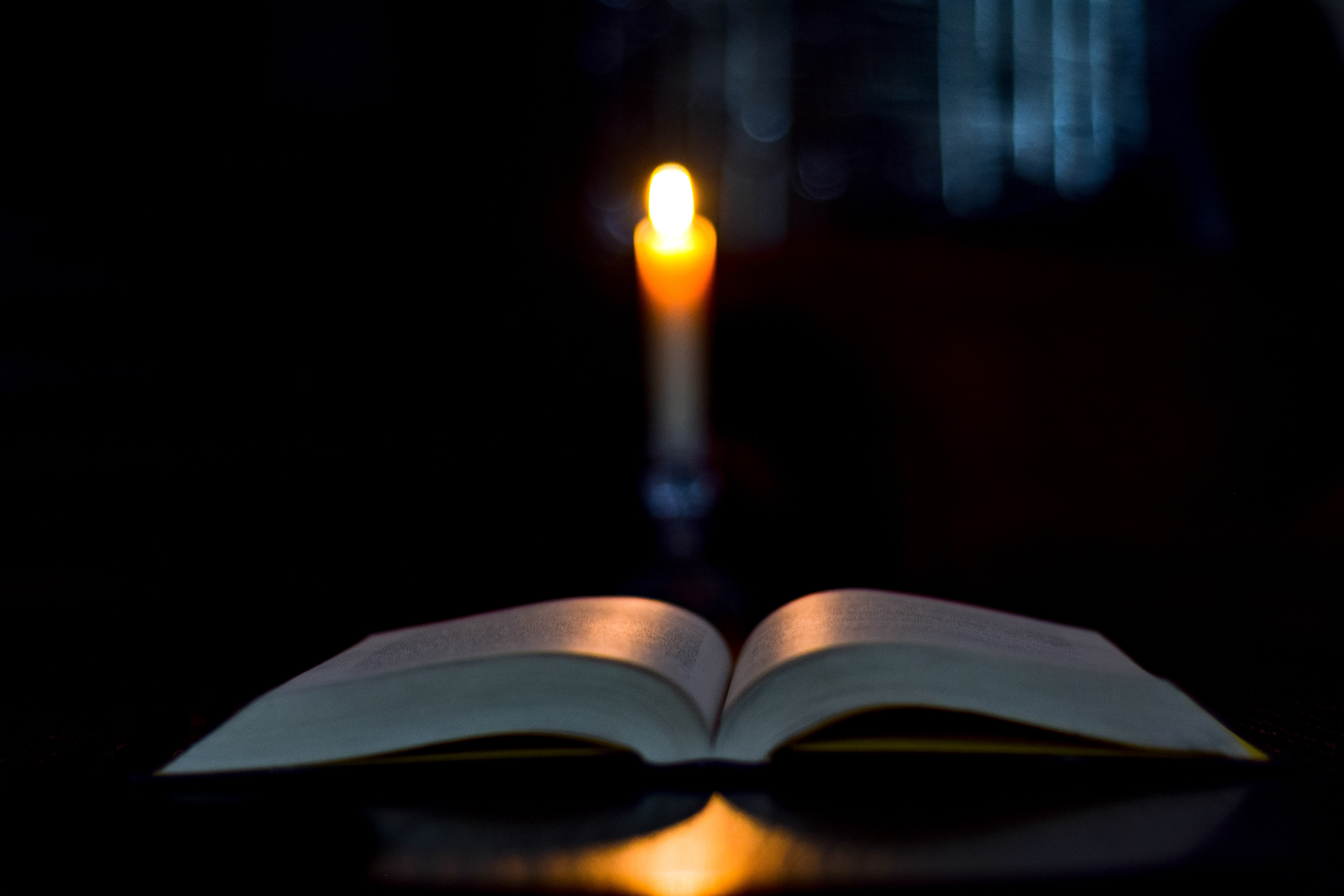 Free stock photo of Book Lit By Candlelight