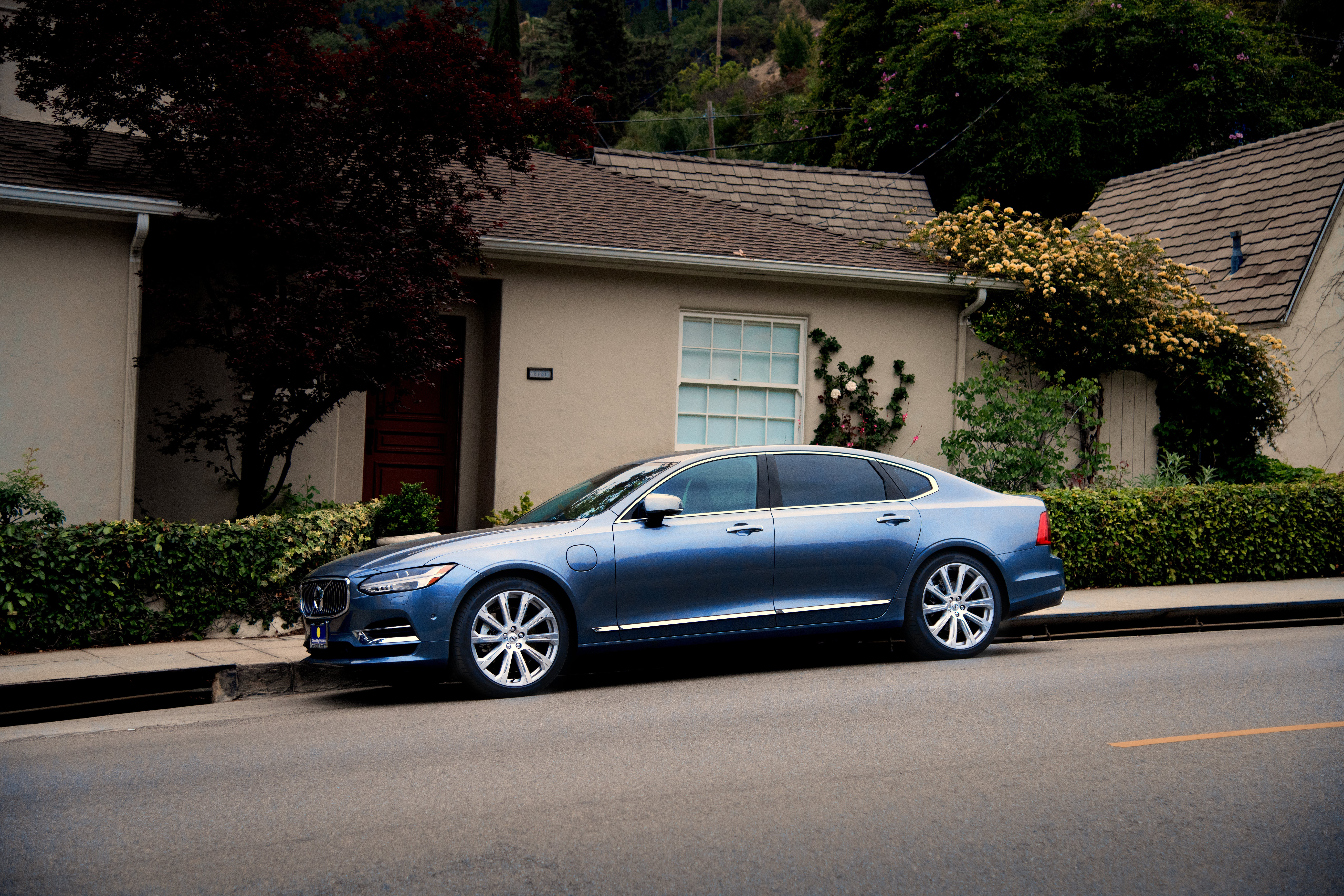 Photo of Blue Sedan Parked on the Side of the Road