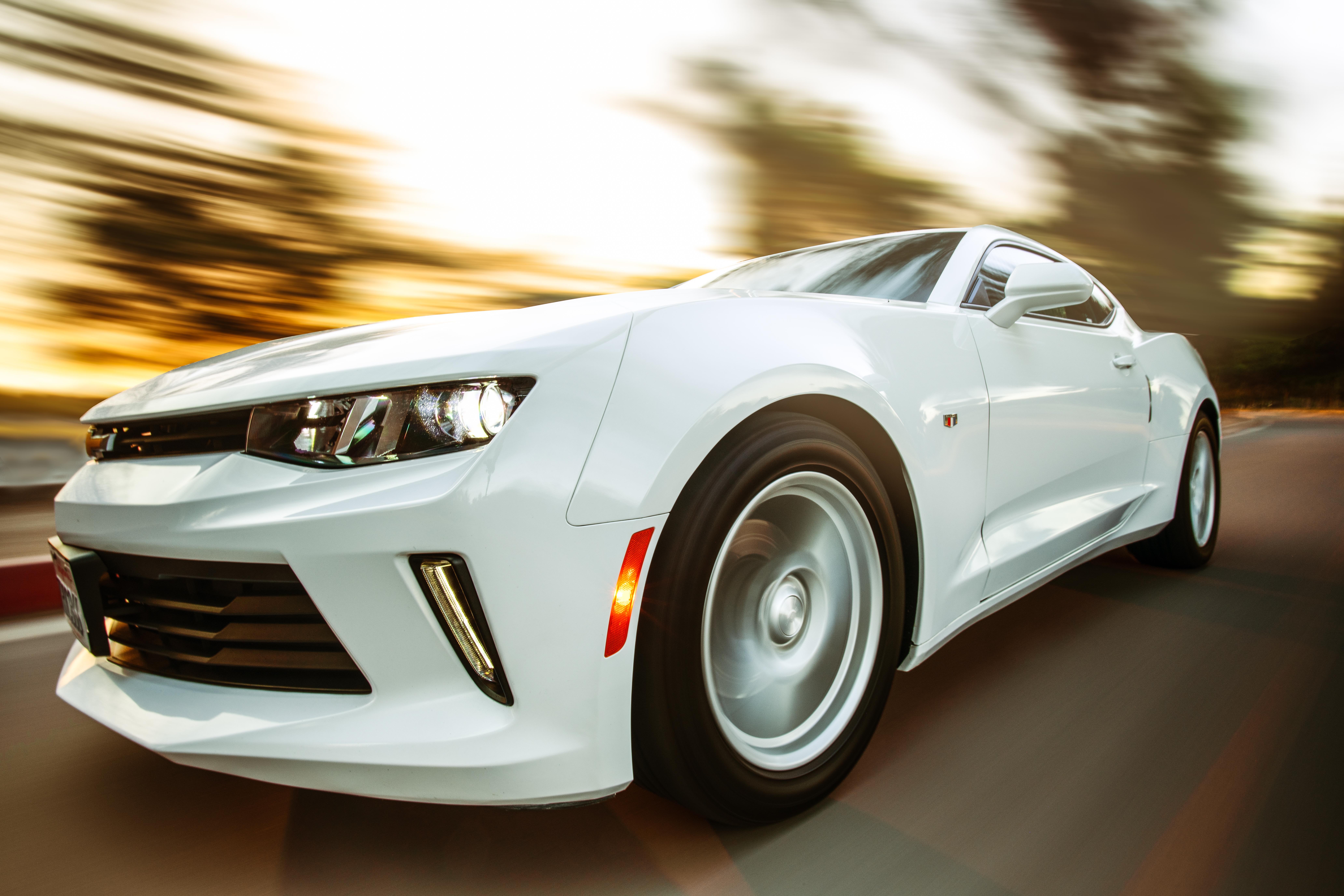 Close-Up Photography of White Chevrolet Camaro