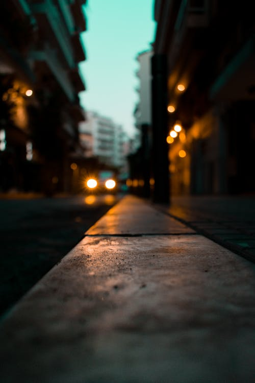 Selective Focus Photography of Gray Concrete Road