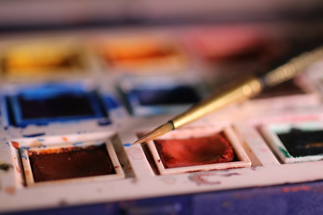 Selective Focus Photography Of Paint Brush On Paint Palette