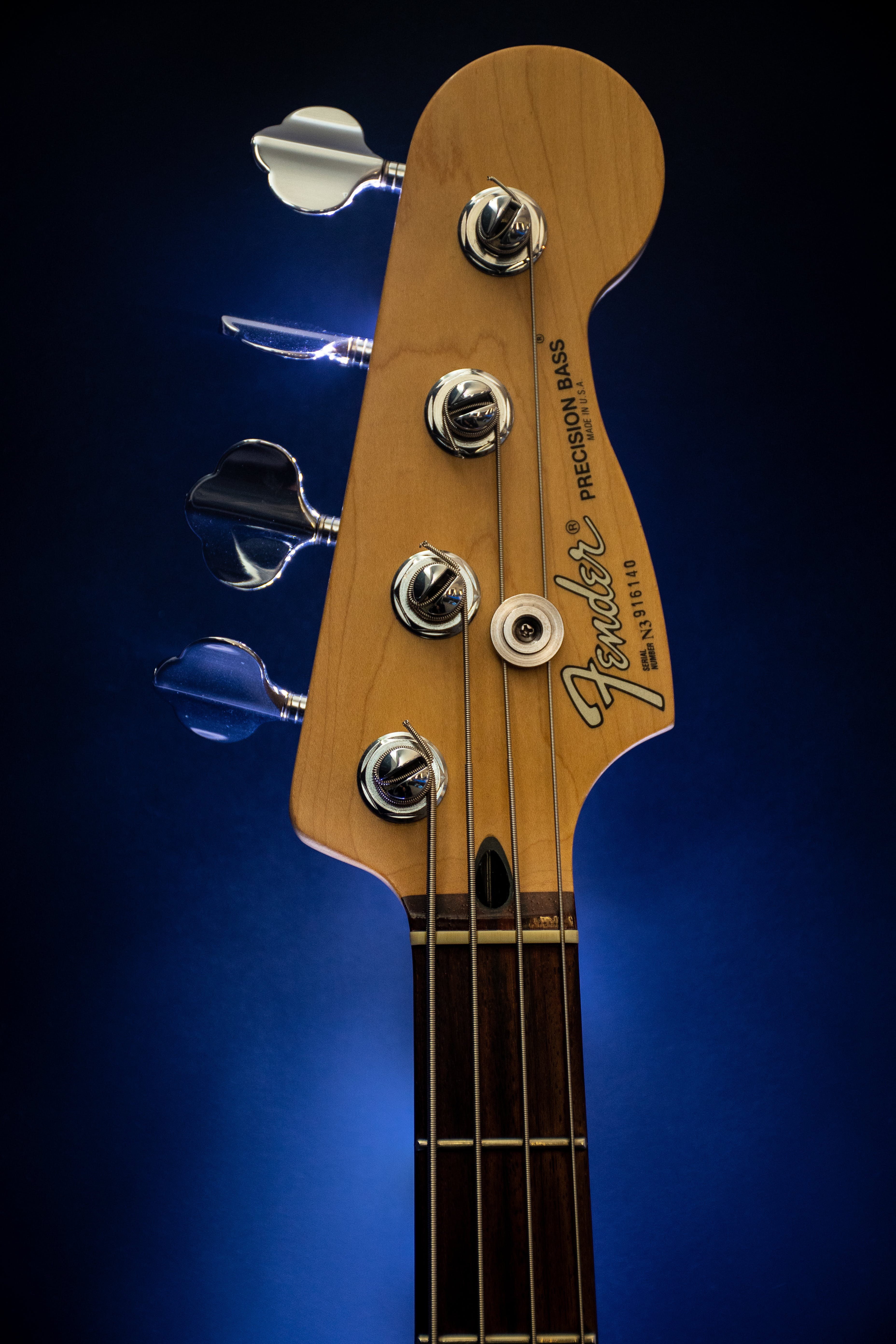 Close-Up Photography of Brown Fender Guitar Headstock