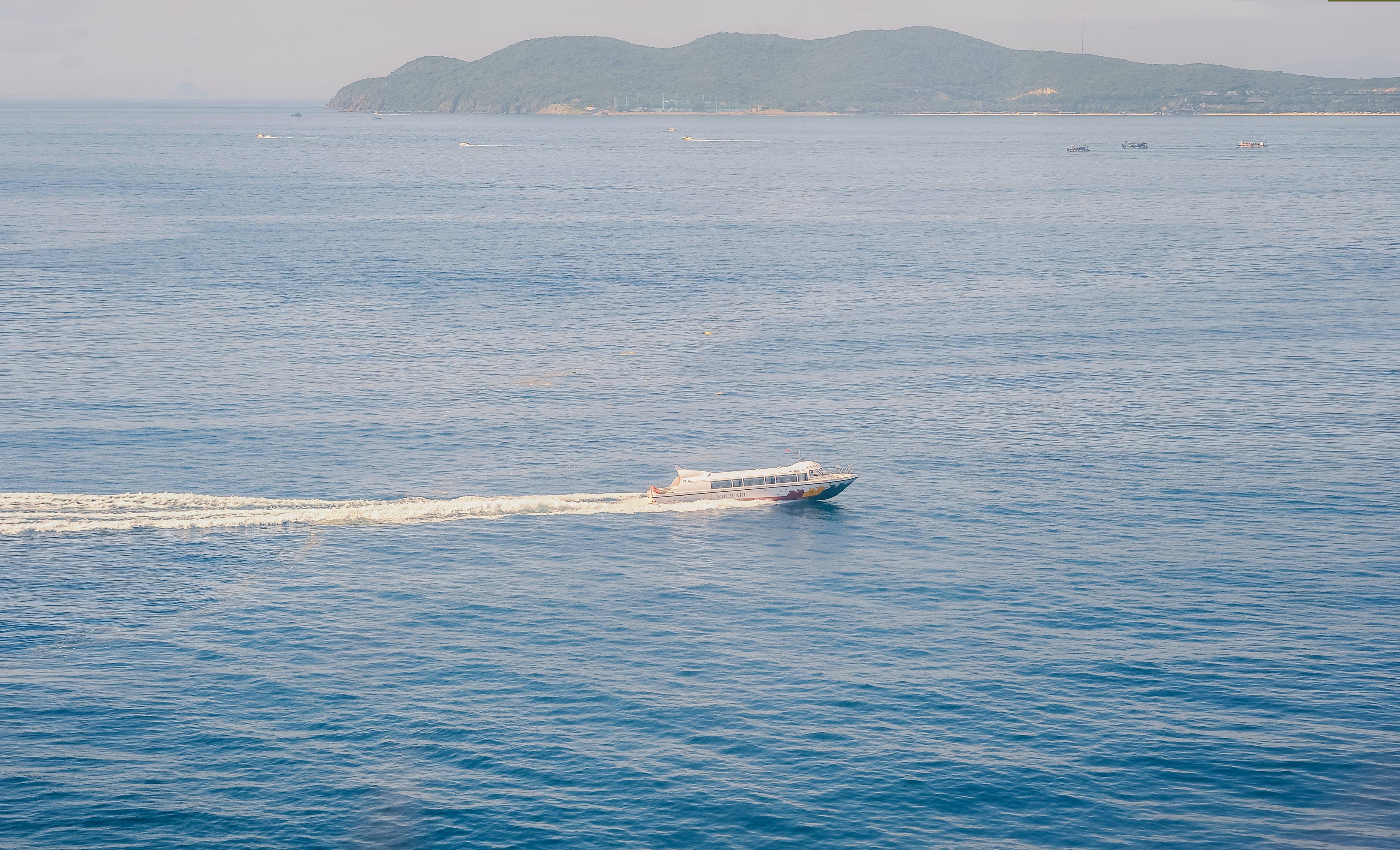 Aerial Photo of White Motor Boat on Ocean