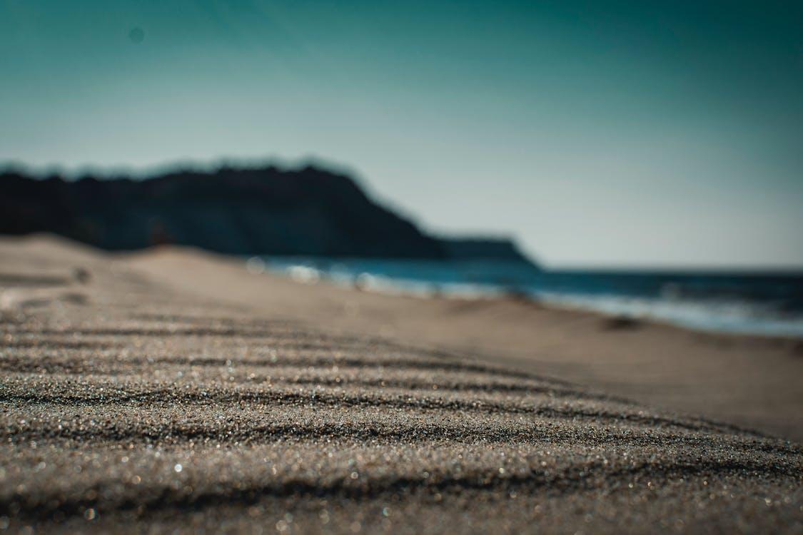 Closed Up Photo of Sand Near Beach