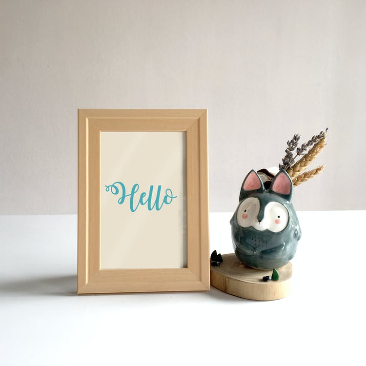 Brown Photo Frame On Top Of White Surface