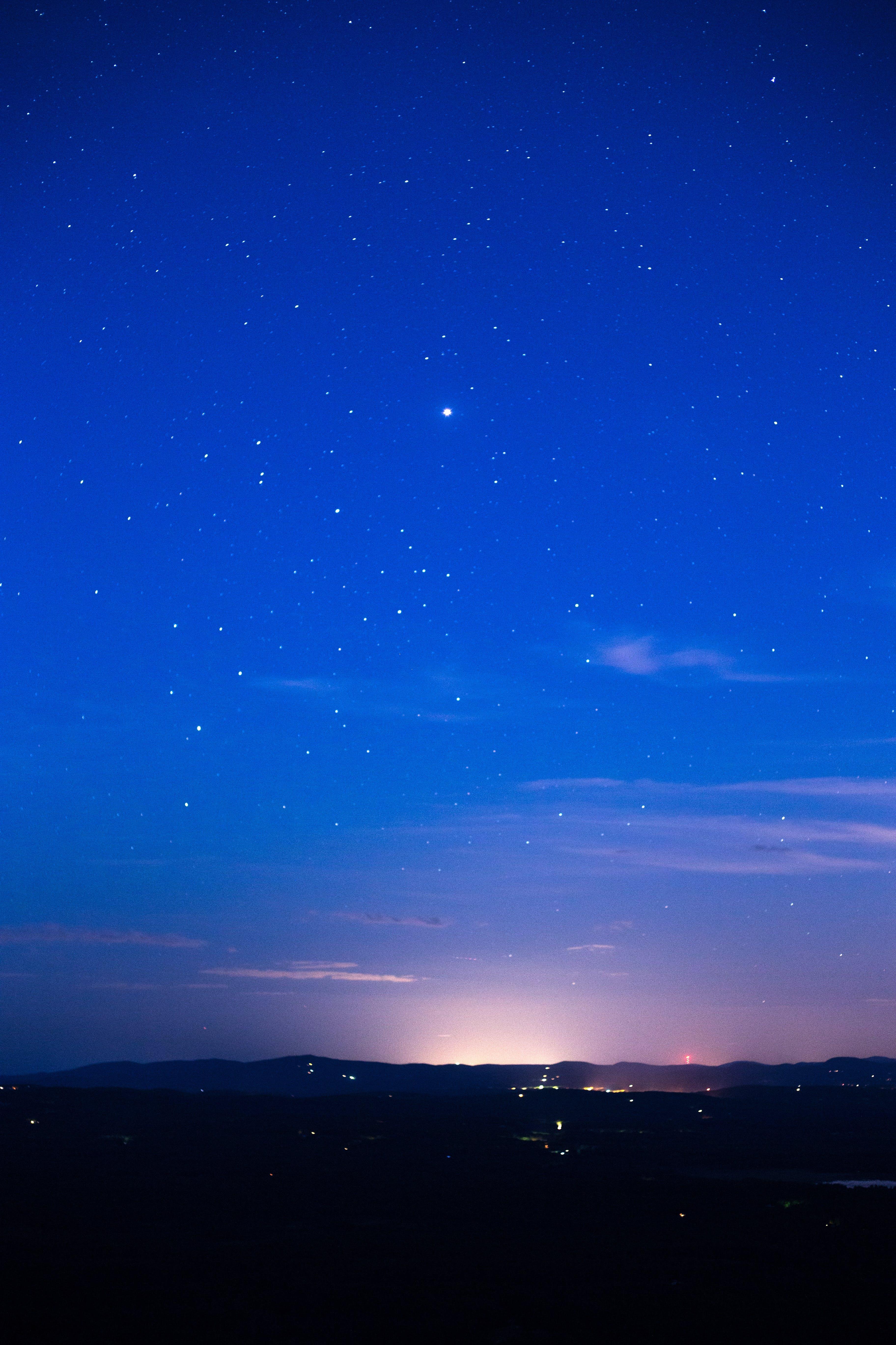 Silhouette of Mountain Range Under Stars