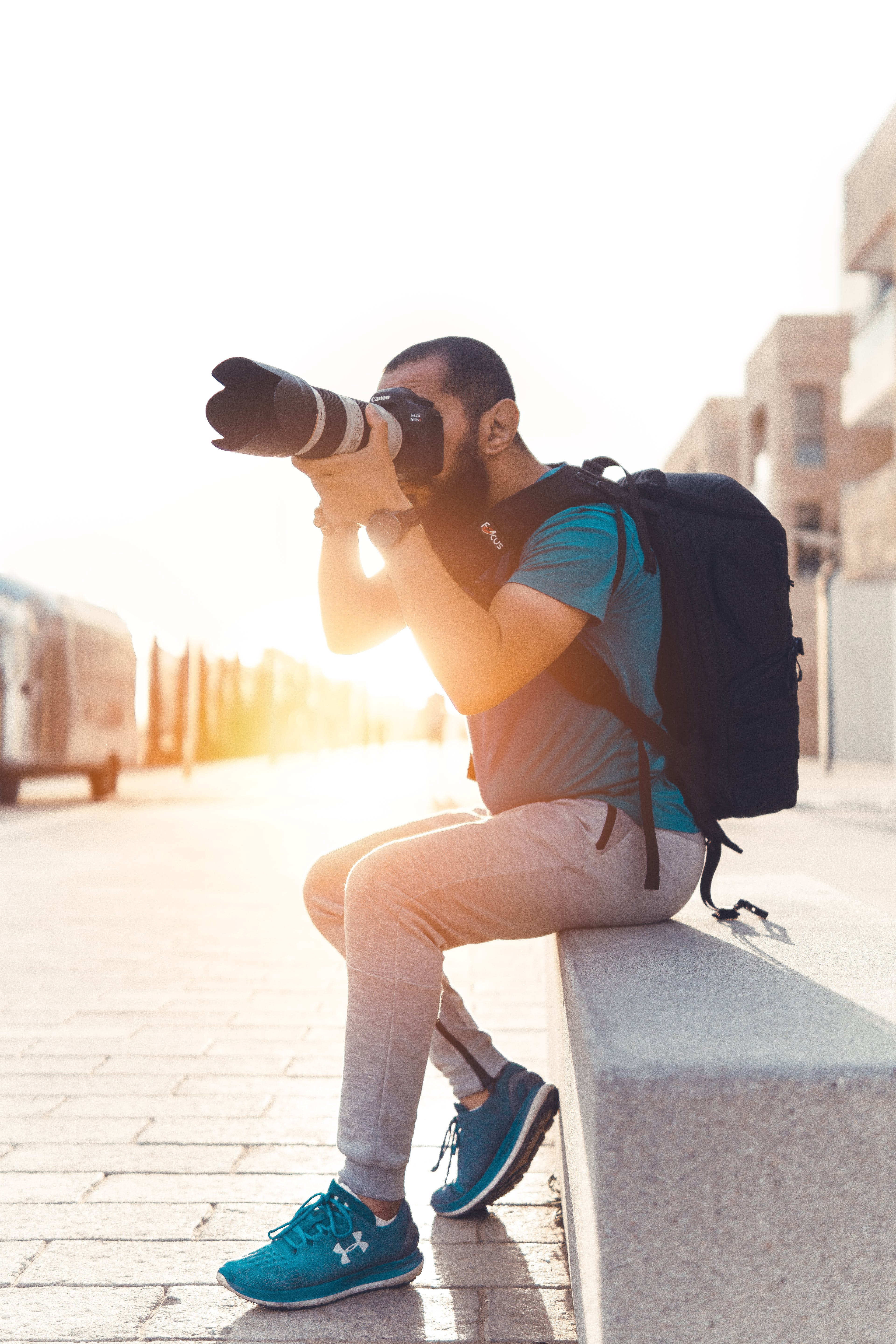 Man Carrying Backpack Taking Photo Using Dslr Camera