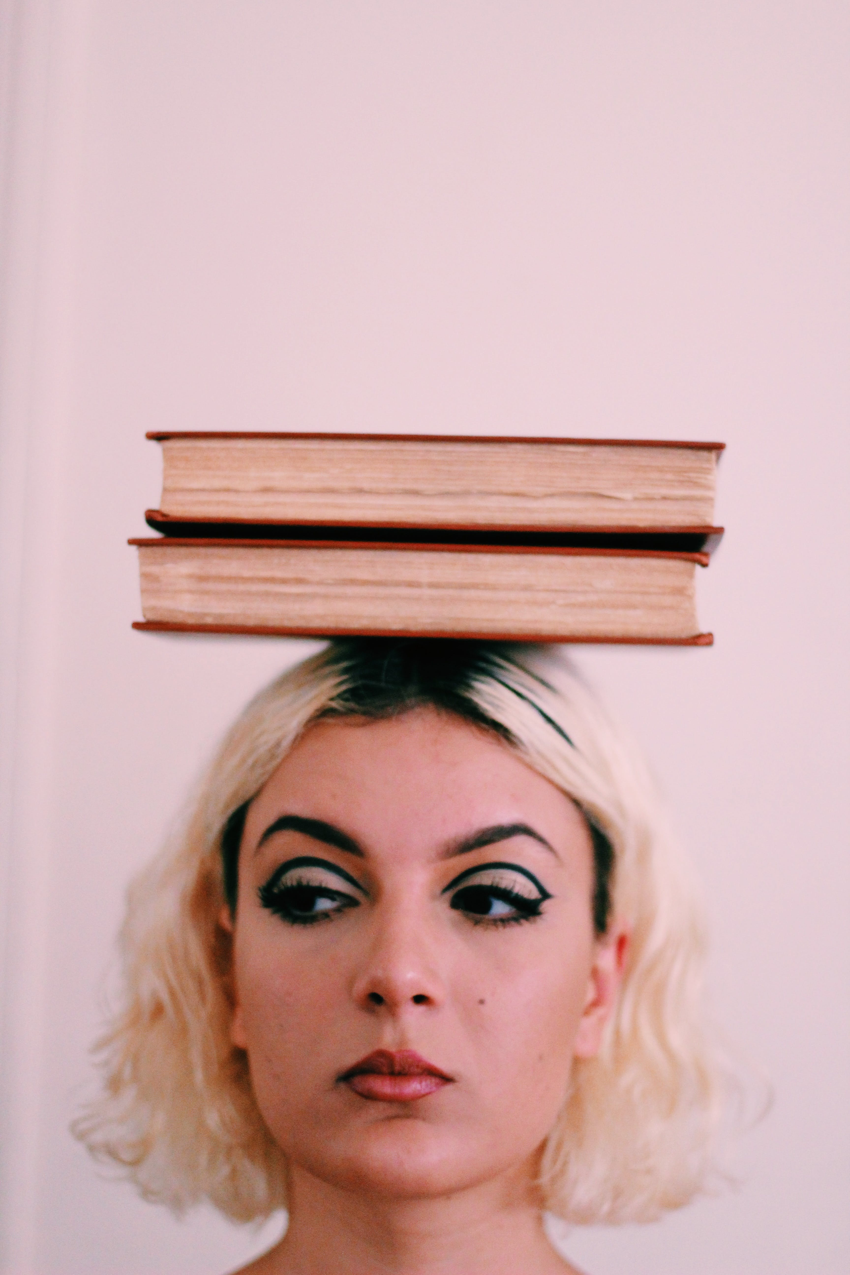 Two Book on Woman' Head