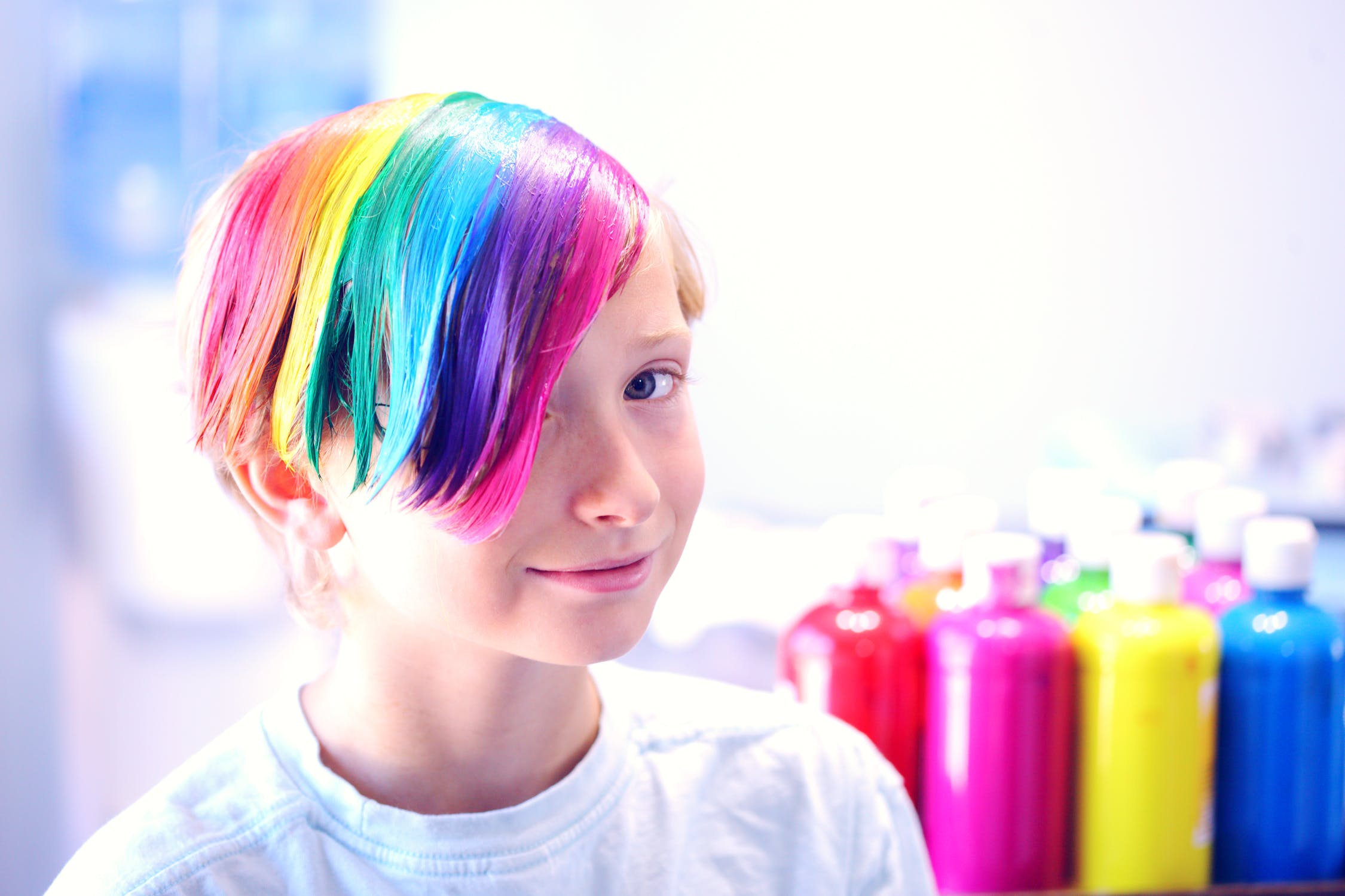 This LGBTQ+ boy has painted his hair with the very, very, very silly LGBTQ+ flag...………...