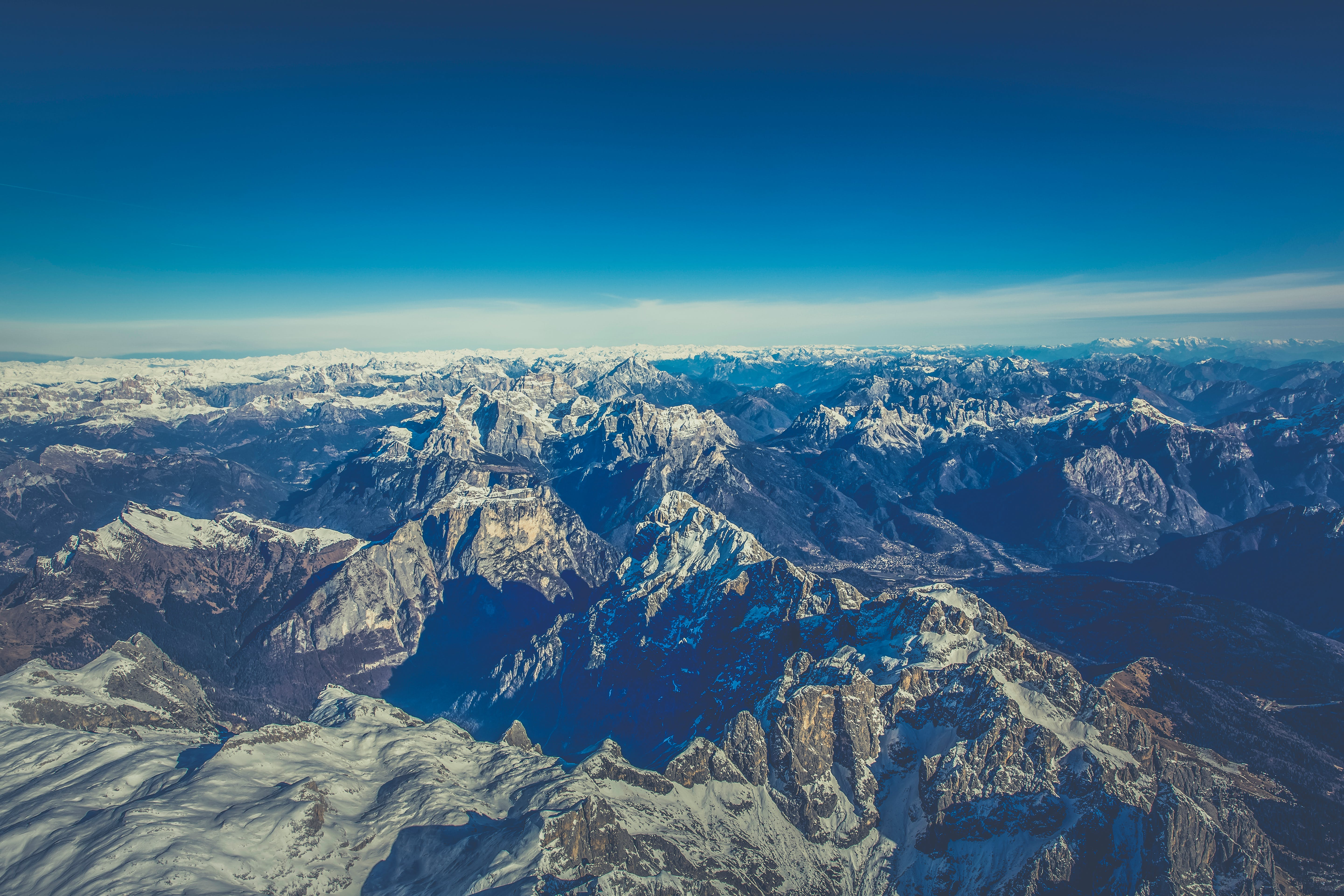 Aerial View of Mountain Under Blue Sky during Day Time